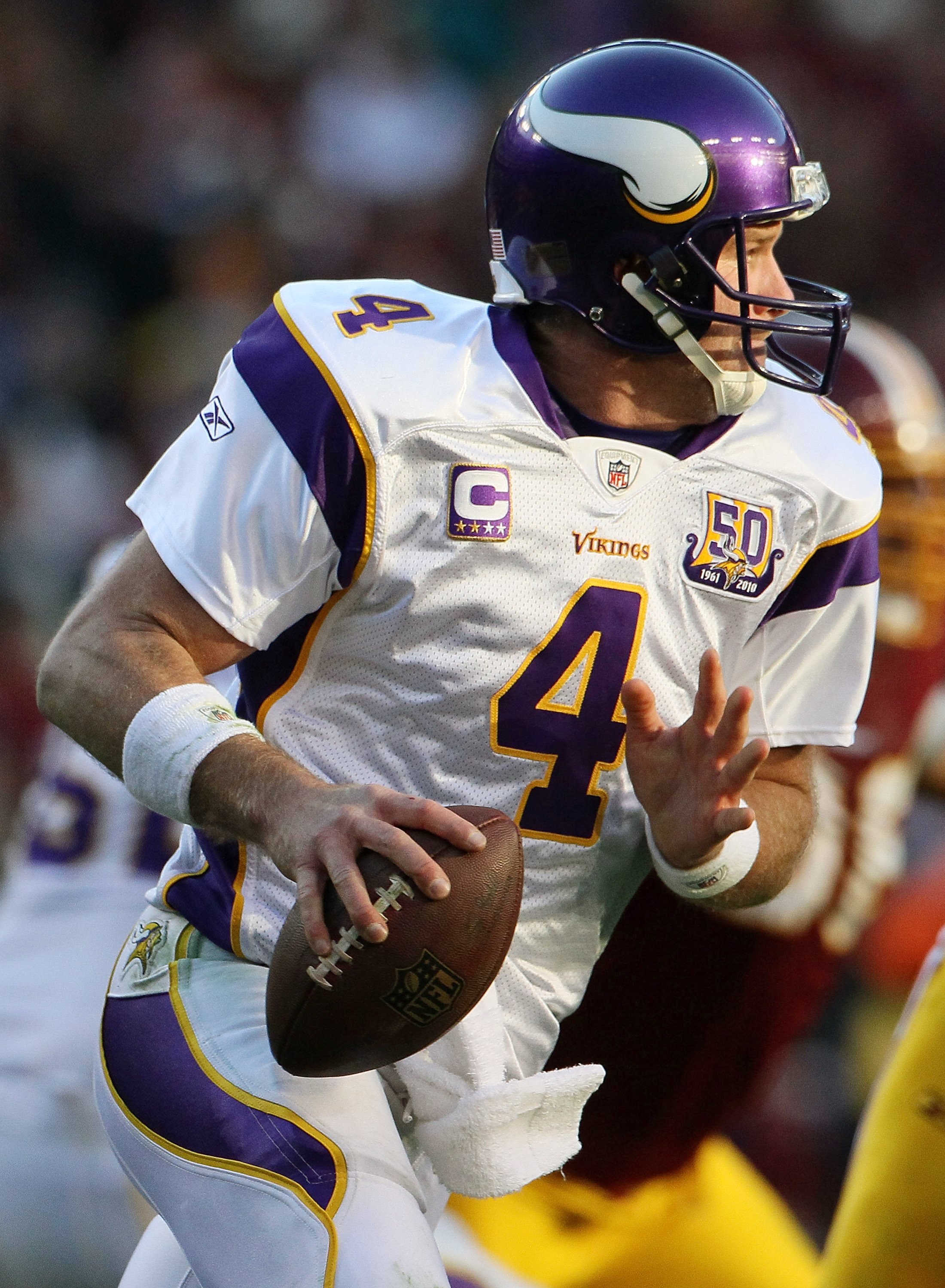 LANDOVER, MD - NOVEMBER 28:  Brett Favre #4 of the Minnesota Vikings scrambles against the Washington Redskins at FedExField November 28, 2010 in Landover, Maryland. The Vikings won the game 17-13.  (Photo by Win McNamee/Getty Images)