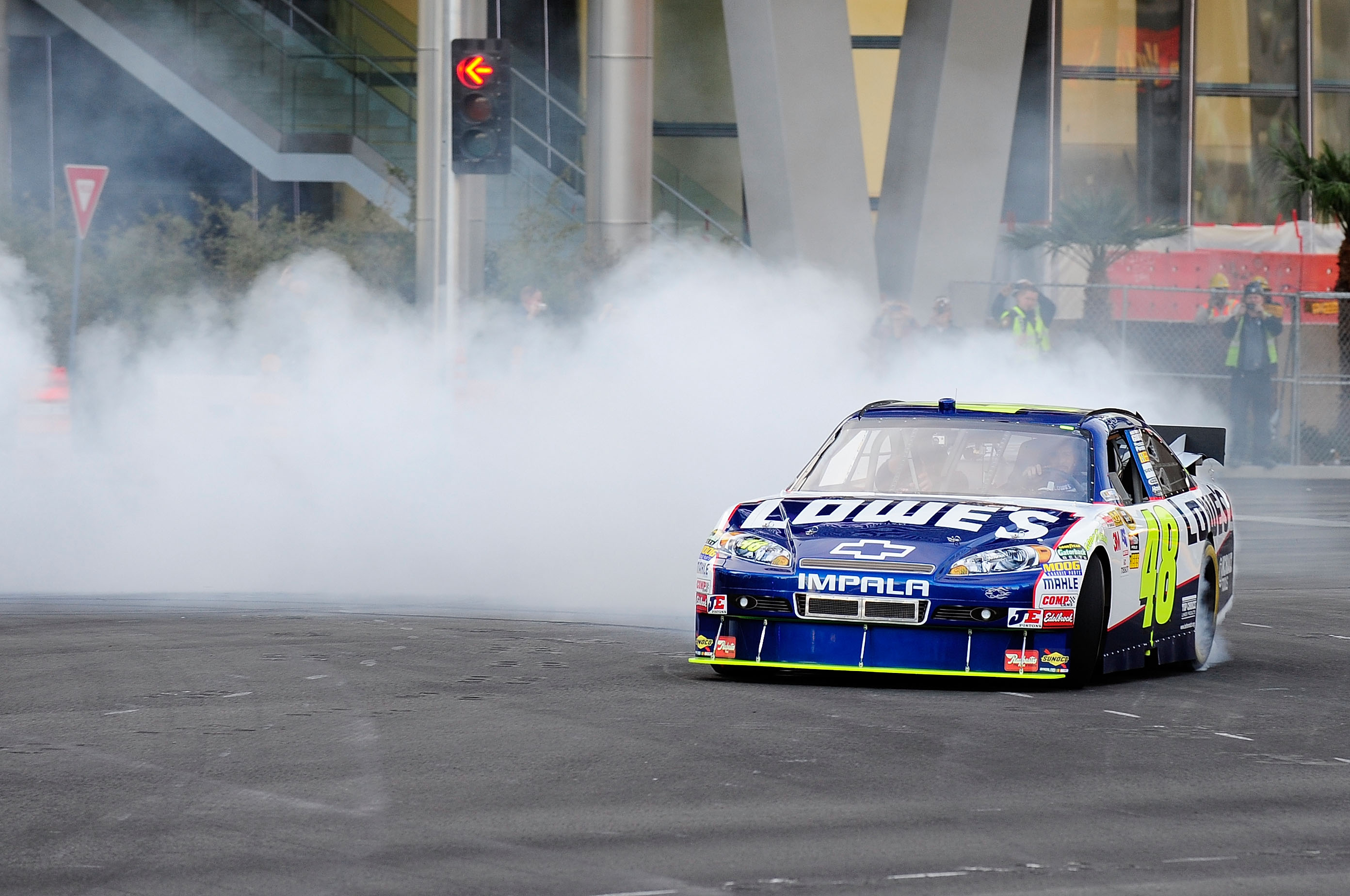 Jimmie Johnson performs donuts on Las Vegas Strip on Las Vegas Blvd and Sands in front of Fashion Show Mall.