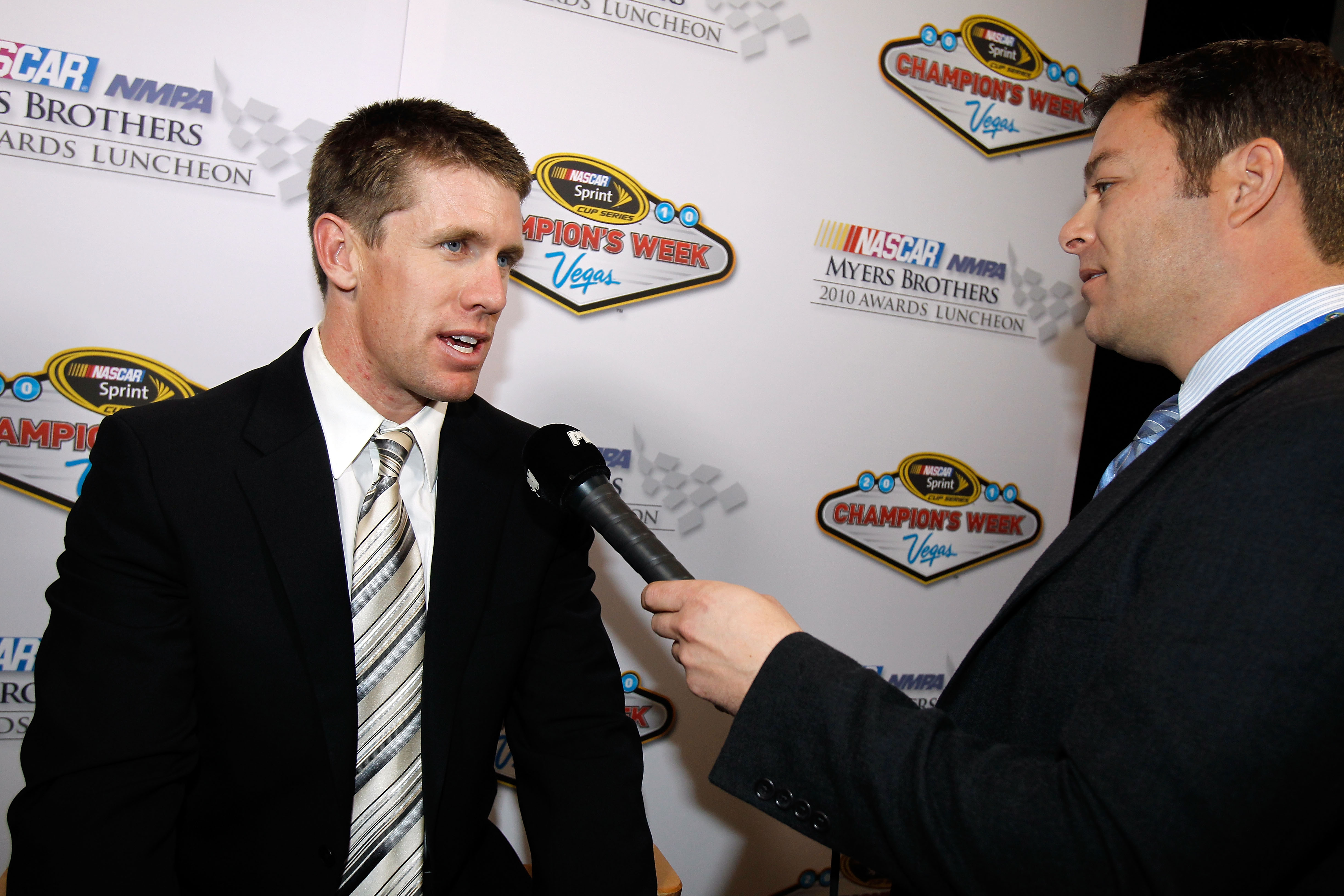 The crowd chanted for Carl Edwards to take off his shirt after a question from a fan.