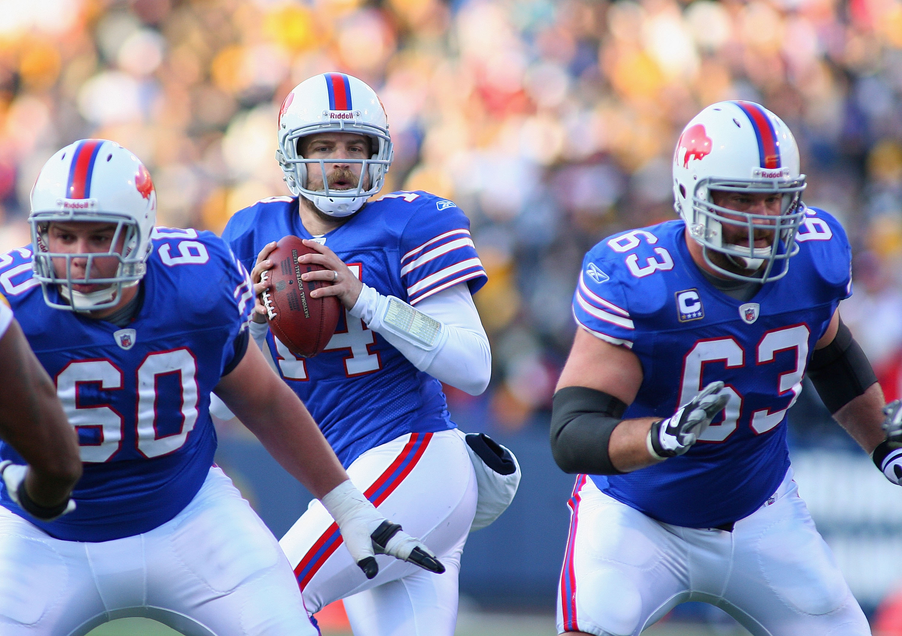 ORCHARD PARK, NY - NOVEMBER 28:  Ryan Fitzpatrick #14  of the Buffalo Bills drops back to throw with protection from Kraig Urbik #60 and Geoff Hangartner #63  against the Pittsburgh Steelers at Ralph Wilson Stadium on November 28, 2010 in Orchard Park, Ne