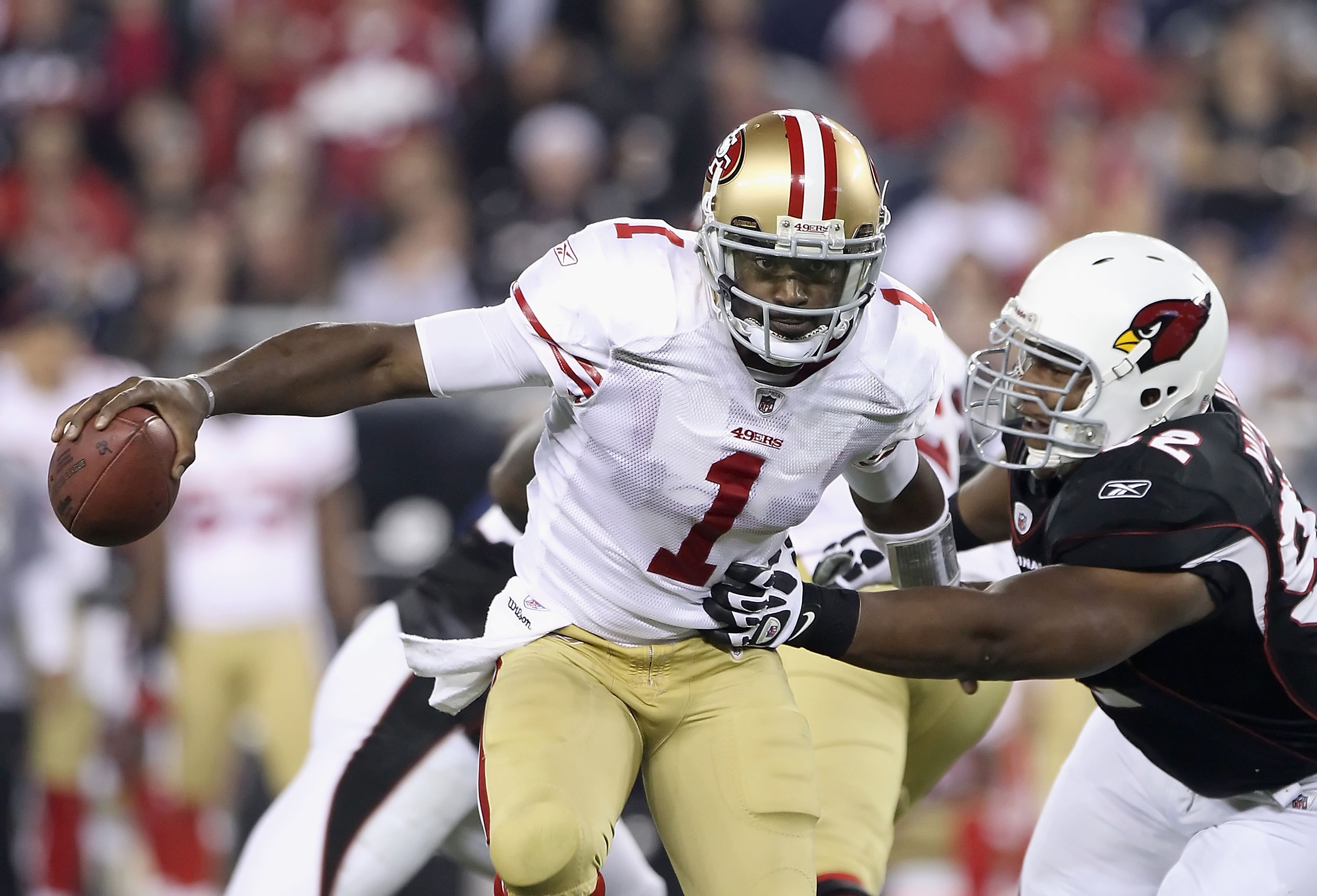 GLENDALE, AZ - NOVEMBER 29:  Quarterback Troy Smith #1 of the San Francisco 49ers scrambles with the football under pressure from Dan Williams #92 of the Arizona Cardinals during the first quarter of the NFL game at the University of Phoenix Stadium on No