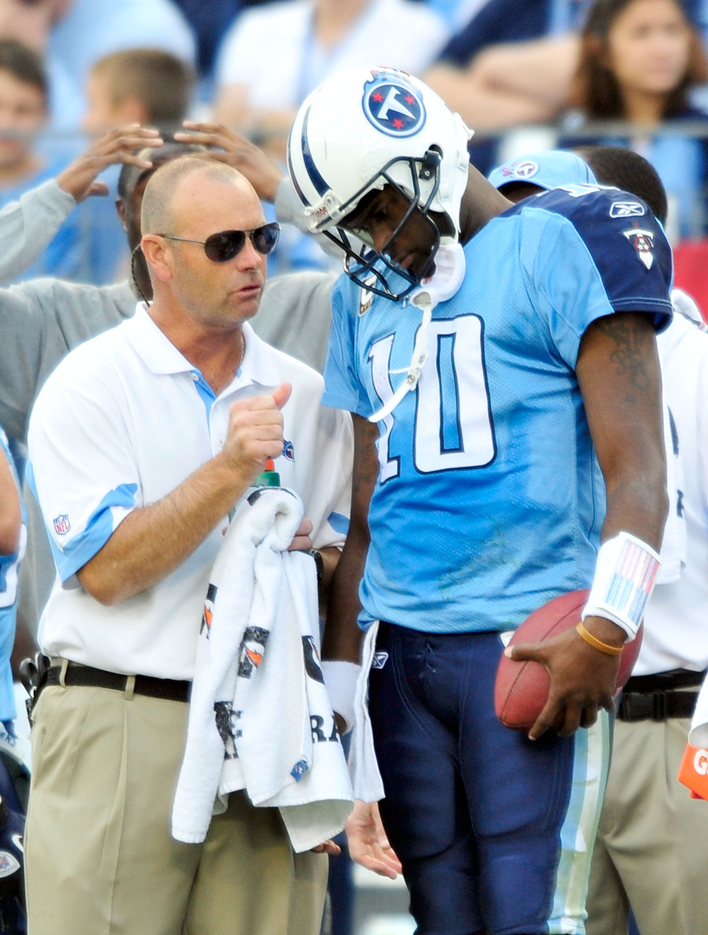 NASHVILLE, TN - NOVEMBER 21:  Quarterback Vince Young #11 of the Tennessee Titans talks with a member of the training staff after leaving a game against the Washington Redskins at LP Field on November 21, 2010 in Nashville, Tennessee. The Redskins won 19-