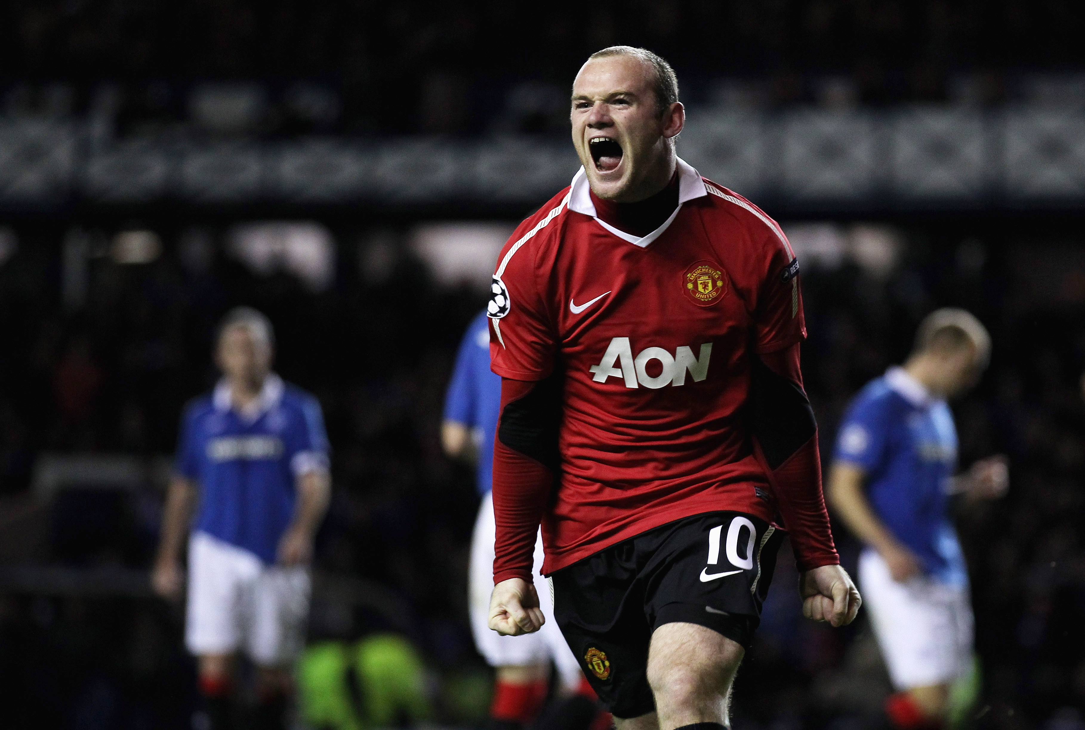 GLASGOW, SCOTLAND - NOVEMBER 24:  Wayne Rooney of Manchester United celebrates after scoring the winning goal from the penalty spot during the UEFA Champions League Group C match between Glasgow Rangers and Manchester United at Ibrox on November 24, 2010