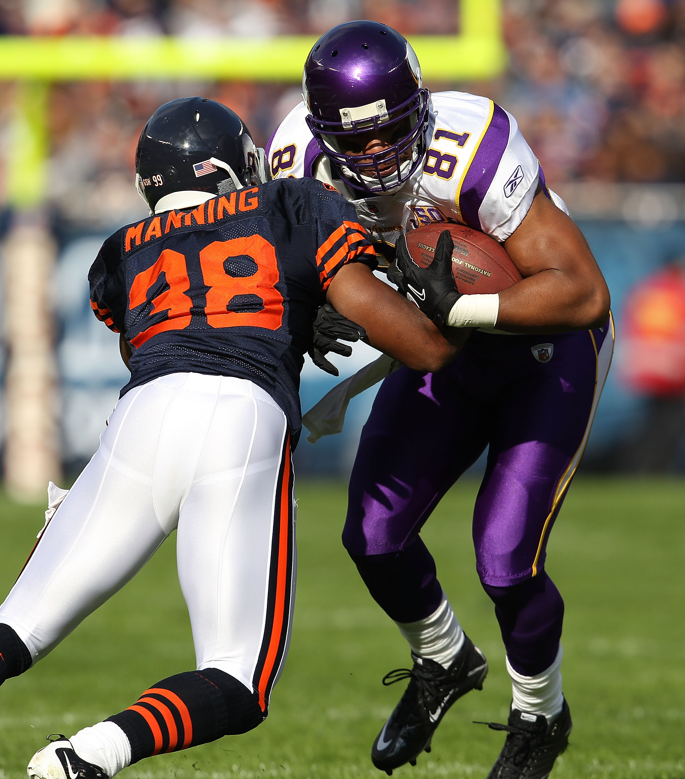 CHICAGO - NOVEMBER 14: Danieal Manning #38 of the Chicago Bears hits Visanthe Shiancoe #81 the Minnesota Vikings at Soldier Field on November 14, 2010 in Chicago, Illinois. The Bears defeated the Vikings 27-13. (Photo by Jonathan Daniel/Getty Images)
