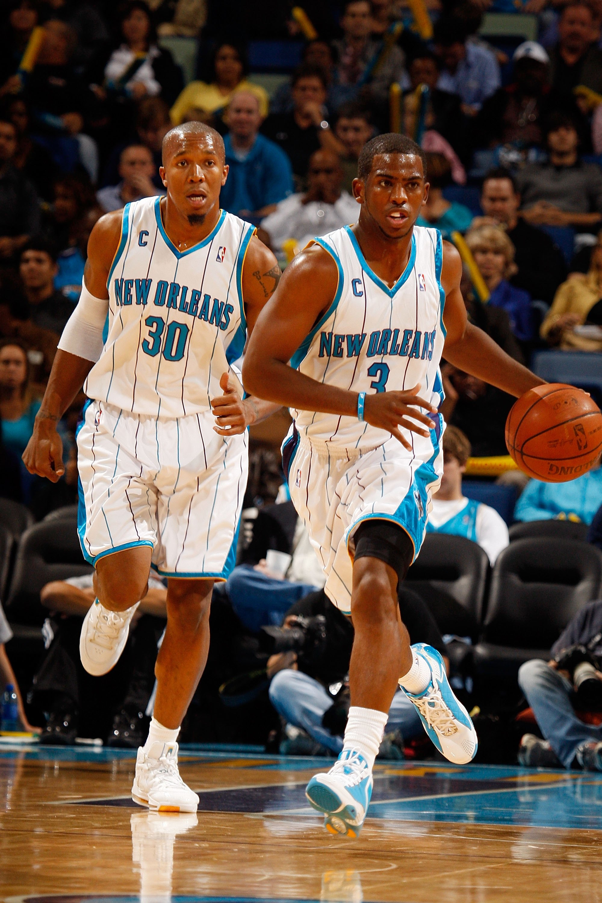 NEW ORLEANS - NOVEMBER 13:  David West #30 and Chris Paul #3 of the New Orleans Hornets is carried off the court after falling against the Portland Trail Blazers at the New Orleans Arena on November 13, 2009 in New Orleans, Louisiana.  NOTE TO USER: User