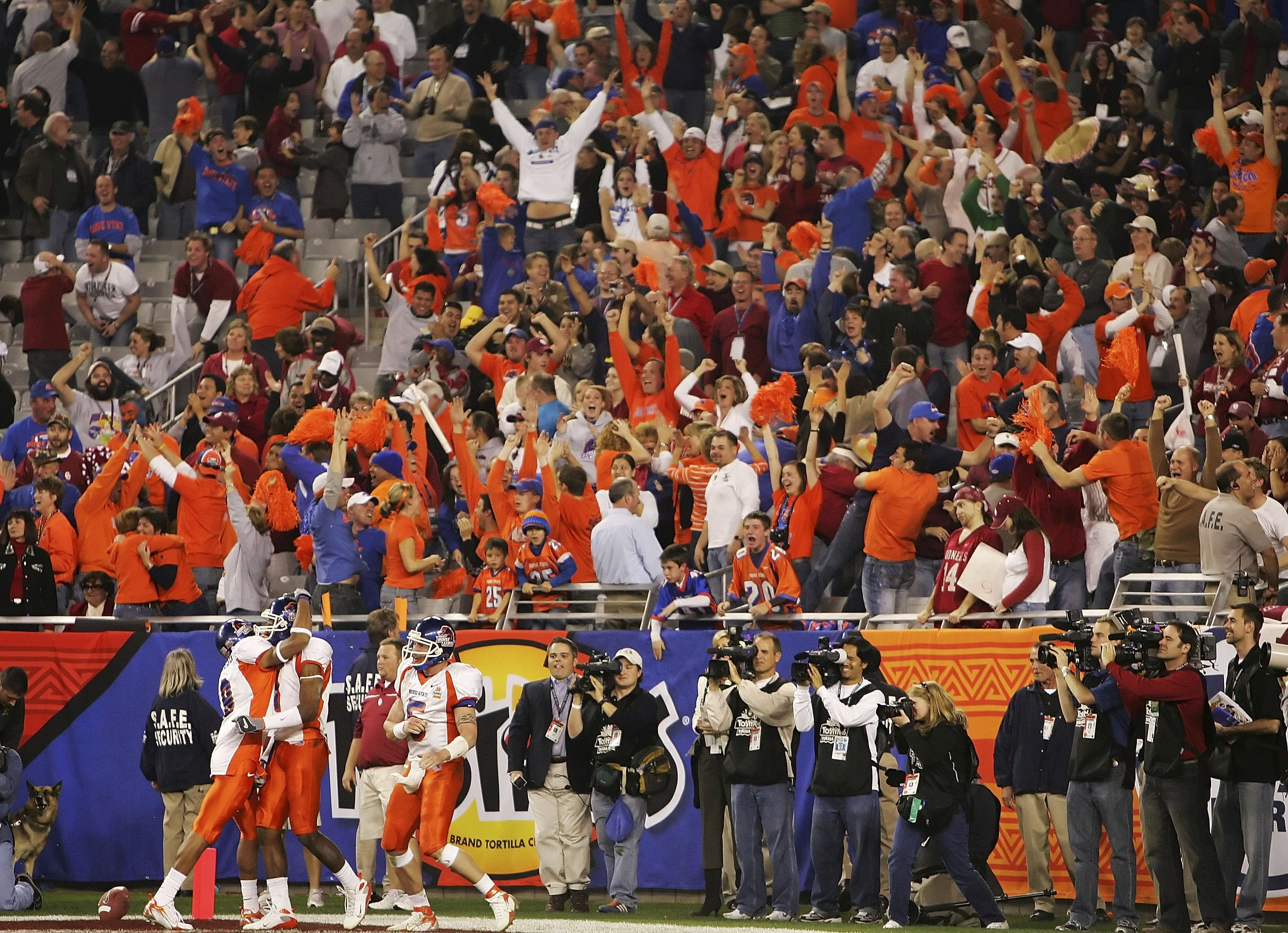 GLENDALE, AZ - JANUARY 01:  (L-R) Jeremy Childs #9, Jerad Rabb #1 and Jared Zabransky #5 of the Boise State Broncos celebrates the Rabb touchdown late in the fourth quarter against the Oklahoma Sooners at the Tostito's Fiesta Bowl at University of Phoenix