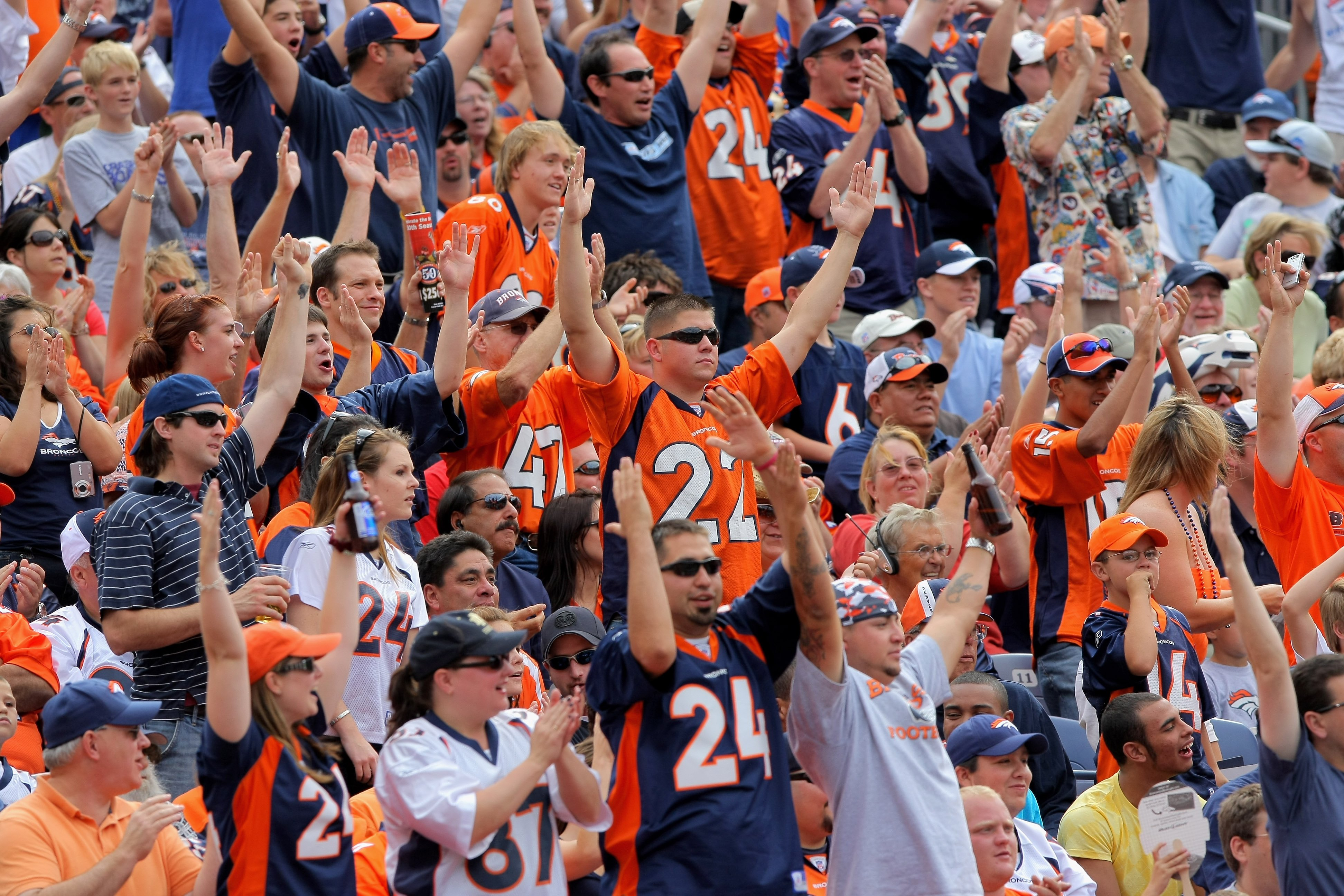 DENVER - SEPTEMBER 20:  Fans of the Denver Broncos cheer a touchdown against the Cleveland Browns during NFL action at Invesco Field at Mile High on September 20, 2009 in Denver, Colorado. The Broncos defeated the Browns 27-6.  (Photo by Doug Pensinger/Ge