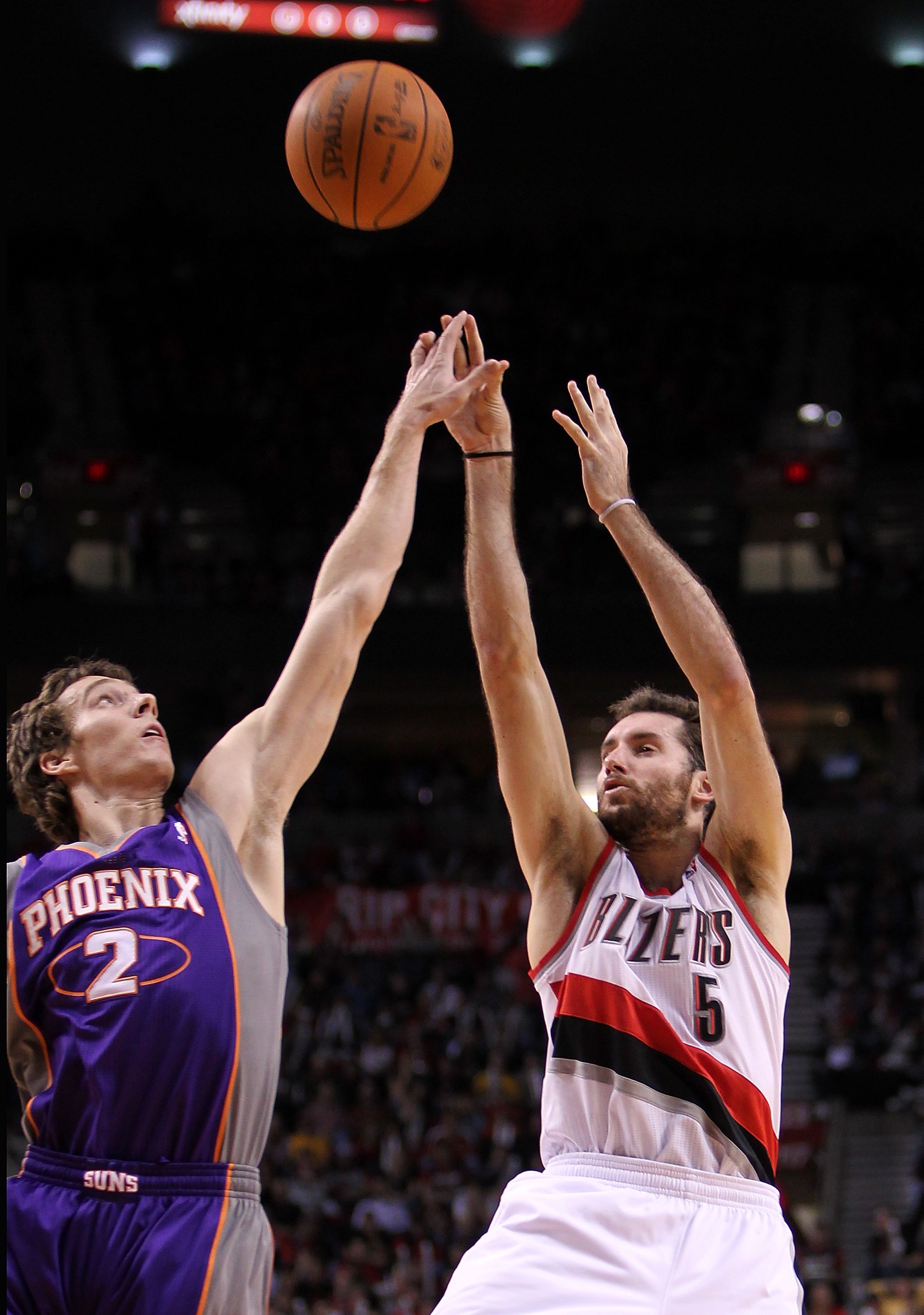 PORTLAND, OR - OCTOBER 26:  Rudy Fernandez #5 of the Portland Trail Blazers shoots the ball over Goran Dragic #2 of the Phoeninx Suns on October 26, 2010 at the Rose Garden in Portland, Oregon.  NOTE TO USER: User expressly acknowledges and agrees that, b