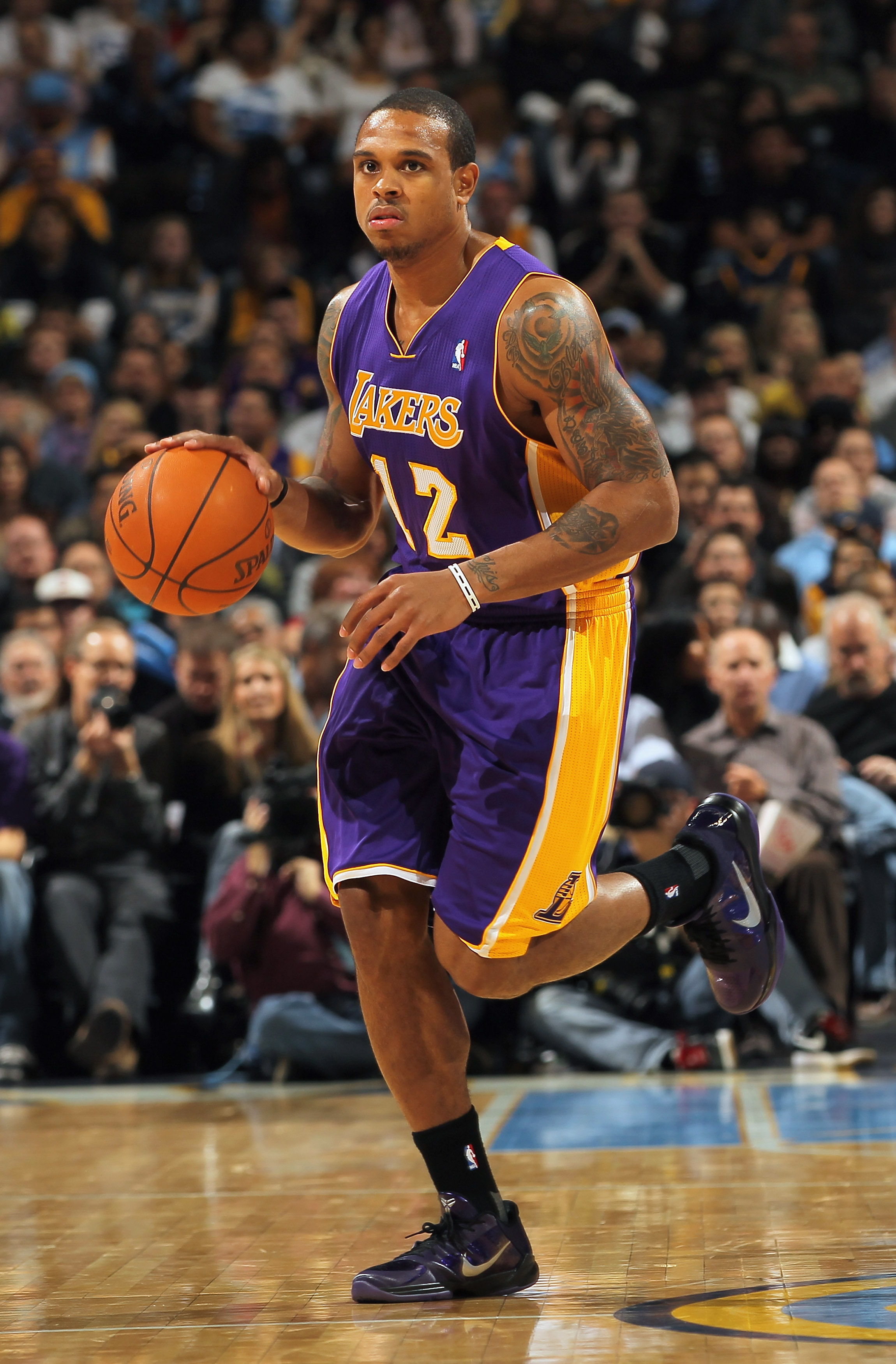 DENVER - NOVEMBER 11:  Shannon Brown #12 of the Los Angeles Lakers controls the ball against the Denver Nuggets at the Pepsi Center on November 11, 2010 in Denver, Colorado. The Nuggets defeated the Lakers 118-112.  NOTE TO USER: User expressly acknowledg