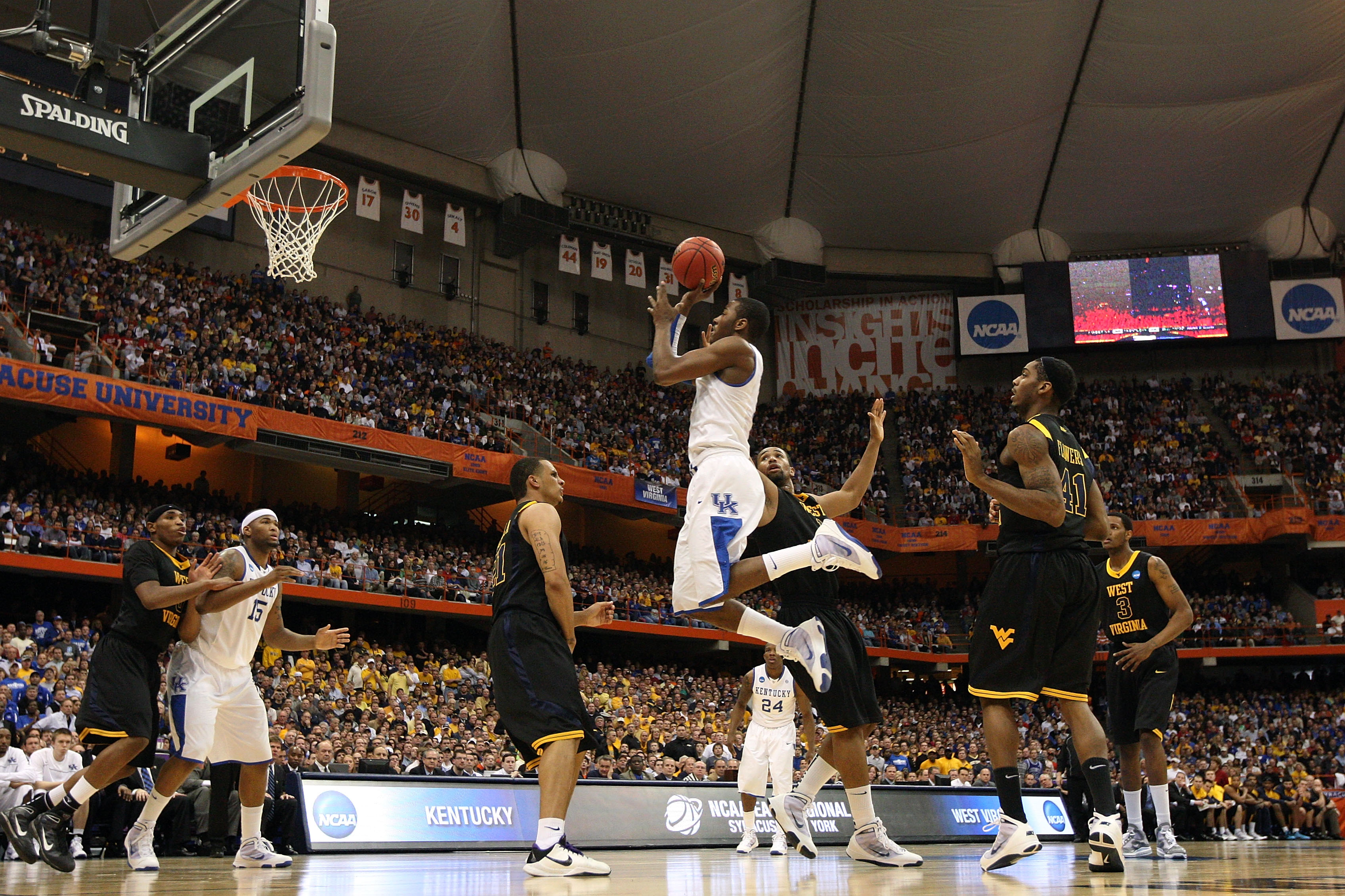 SYRACUSE, NY - MARCH 27:  John Wall #11 of the Kentucky Wildcats drives for a shot attempt against the West Virginia Mountaineers during the east regional final of the 2010 NCAA men's basketball tournament at the Carrier Dome on March 27, 2010 in Syracuse