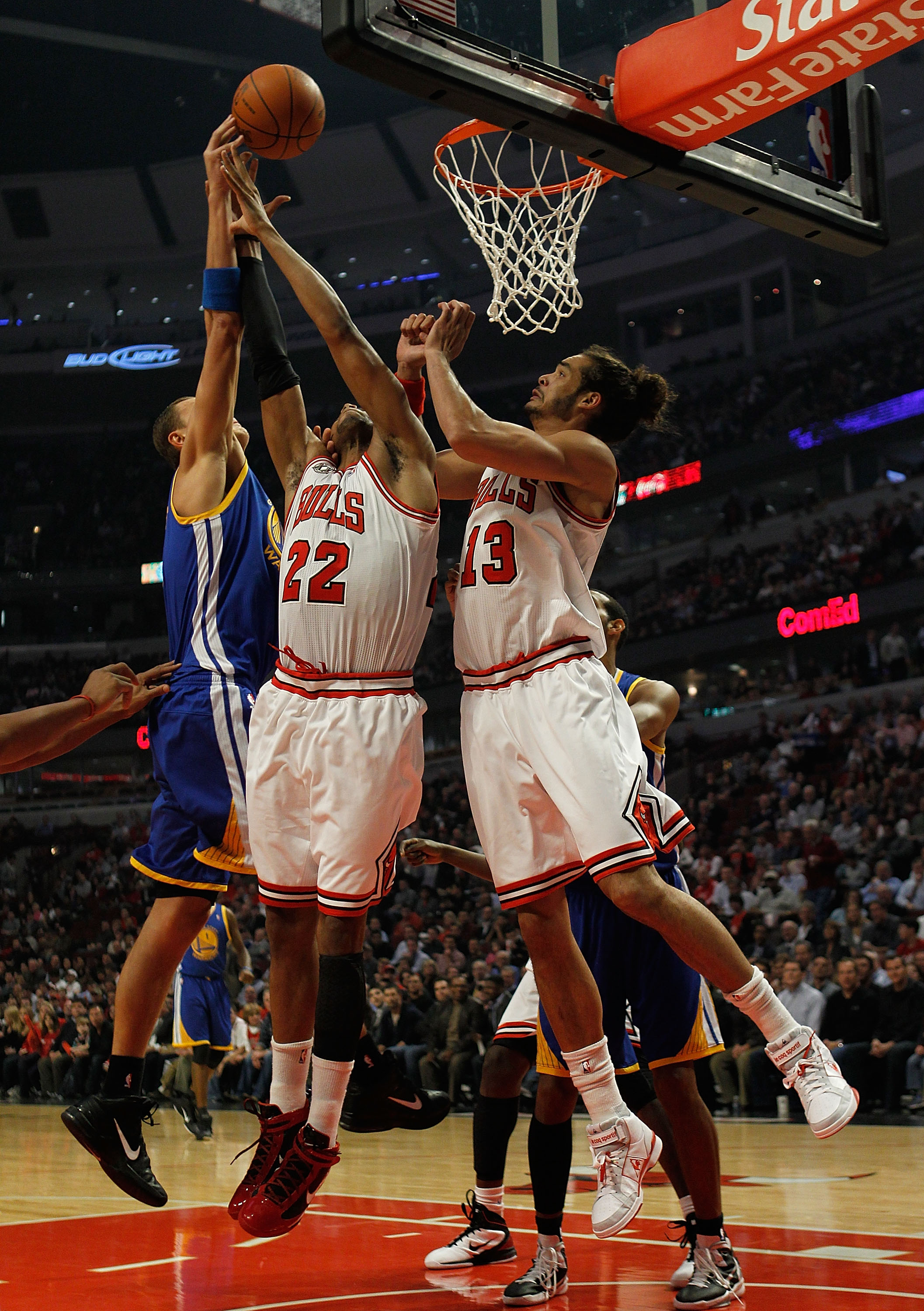 CHICAGO - NOVEMBER 11: Andris Biedrins #15 of the Golden State Warriors battles for a rebound with Taj Gibson #22 and Joakim Noah #13 of the Chicago Bulls at the United Center on November 11, 2010 in Chicago, Illinois. NOTE TO USER: User expressly acknowl