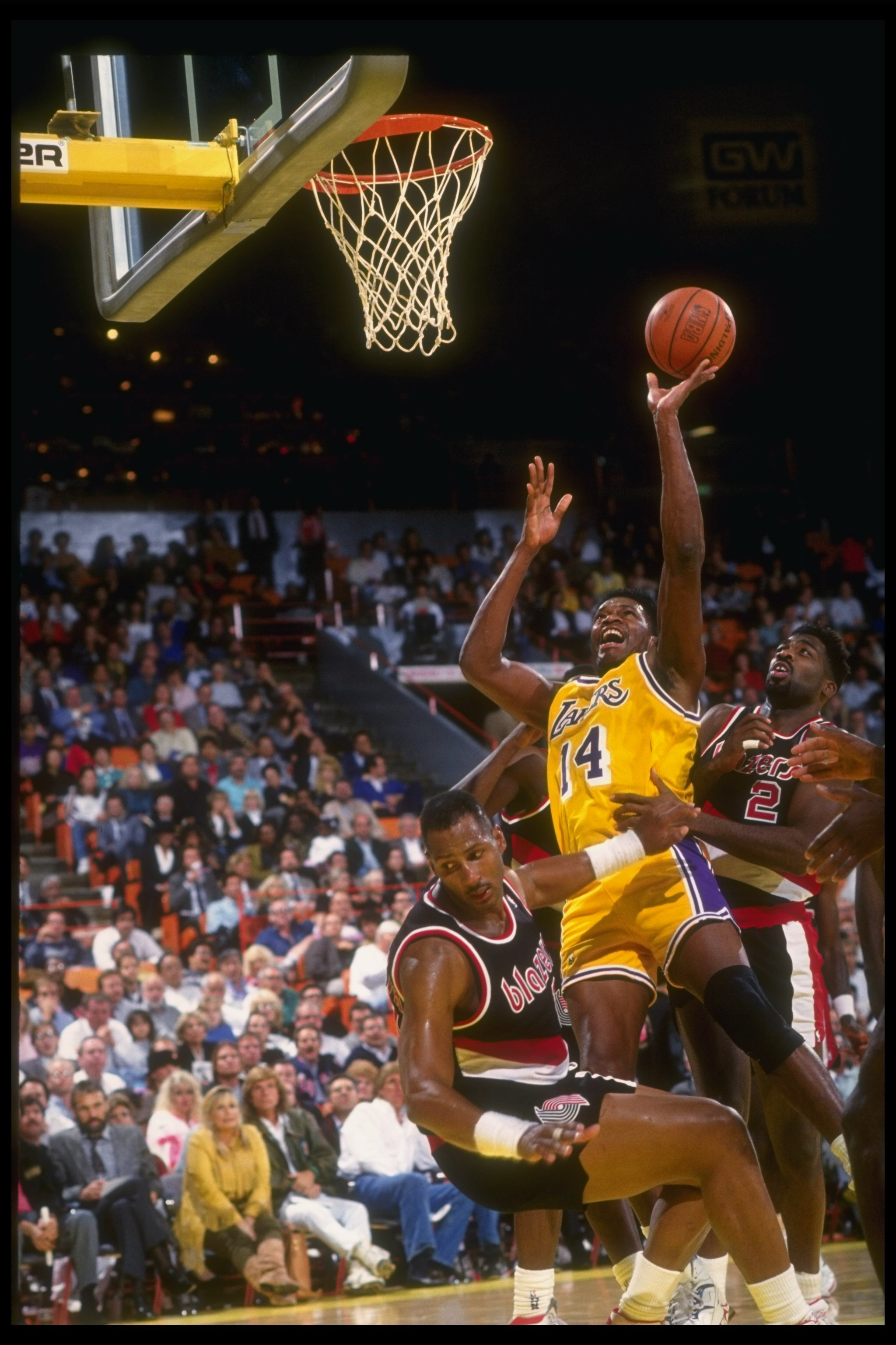 1990-1991:  Forward Sam Perkins of the Los Angeles Lakers goes up for two during a game against the Portland Trail Blazers at the Rose Garden in Portland, Oregon. Mandatory Credit: Stephen Dunn  /Allsport Mandatory Credit: Stephen Dunn  /Allsport