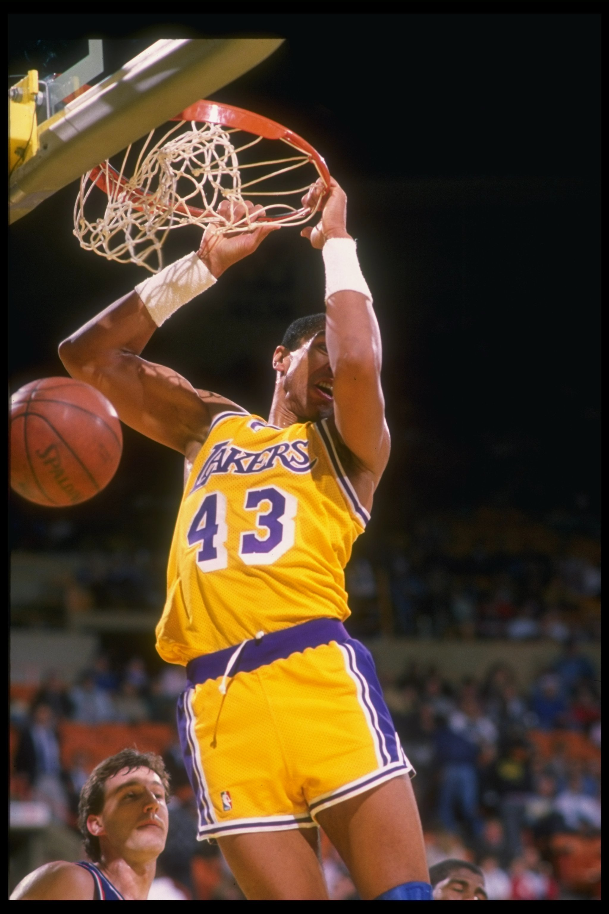 1988-1989:  Mychal Thompson of the Los Angeles Lakers sinks the ball during a game. Mandatory Credit: Mike Powell  /Allsport Mandatory Credit: Mike Powell  /Allsport
