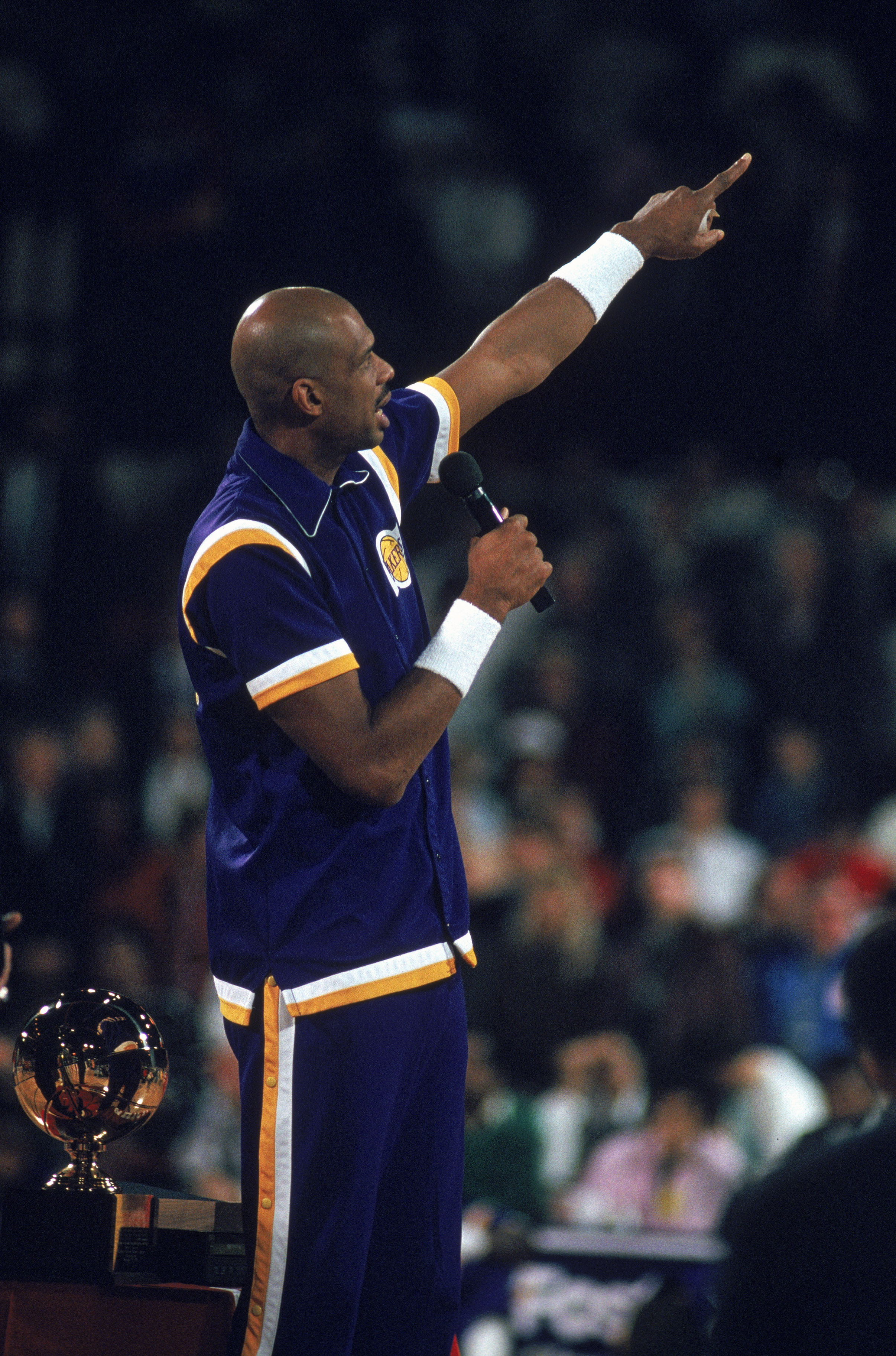 CHICAGO - 1989:  NBA Hall of Fame center Kareem Abdul-Jabbar #33 of the Los Angeles Lakers talks to the crowd after receiving an award during a ceremony at Chicago Stadium in Chicago, Illinois in 1989. (Photo by: Jonathan Daniel/Getty Images)