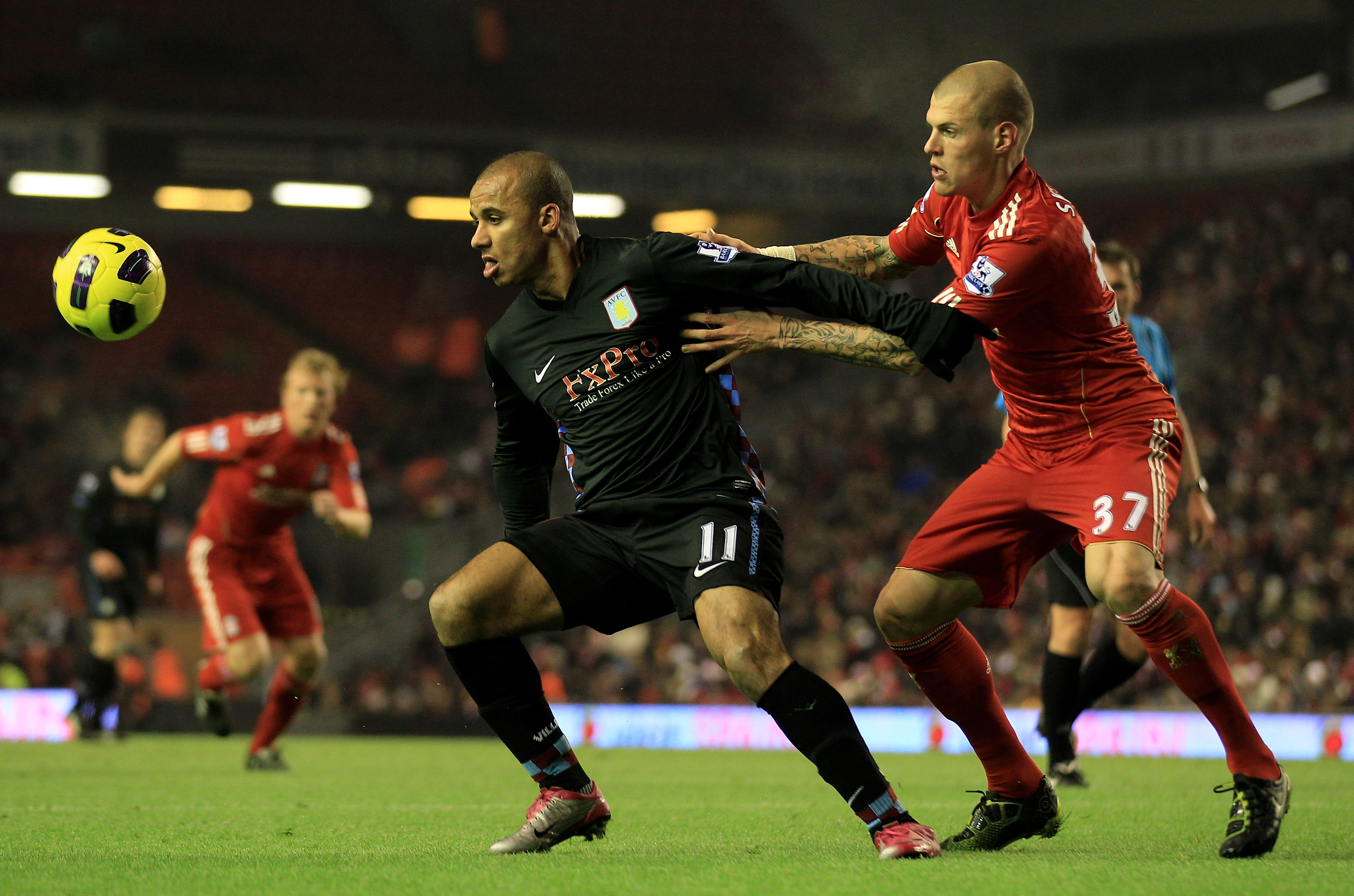 LIVERPOOL, ENGLAND - DECEMBER 06:  Gabriel Agbonlahor of Aston Villa holds off Martin Skrtel of Liverpool during the Barclays Premier League match between Liverpool and Aston Villa at Anfield on December 6, 2010 in Liverpool, England. (Photo by Mark Thomp