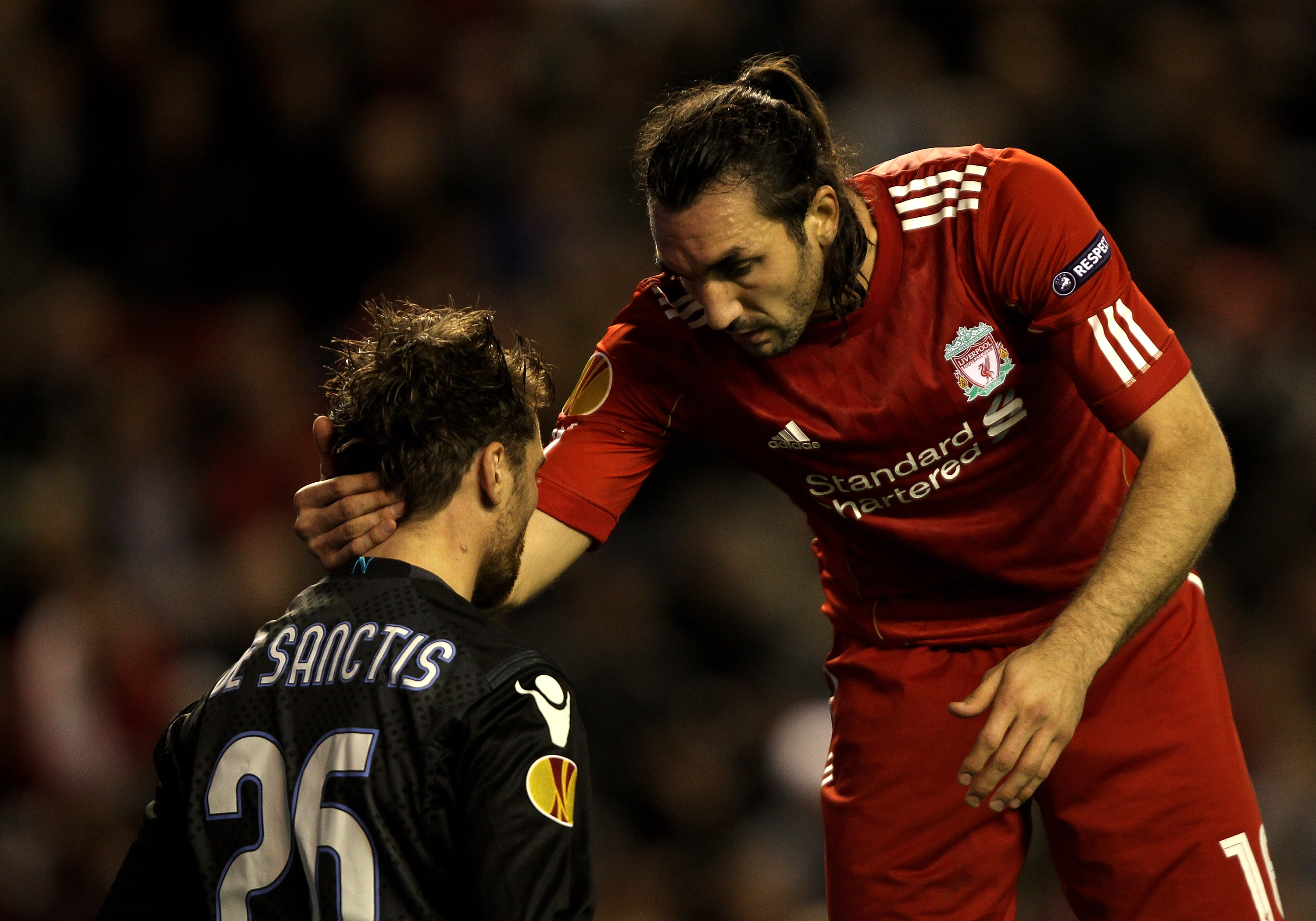 LIVERPOOL, ENGLAND - NOVEMBER 04:   Morgan De Sanctis of Napoli is consoled by Sotiros Kyrgiakos of Liverpool during the UEFA Europa League Group K match beteween Liverpool and SSC Napoli at Anfield on November 4, 2010 in Liverpool, England.  (Photo by Cl