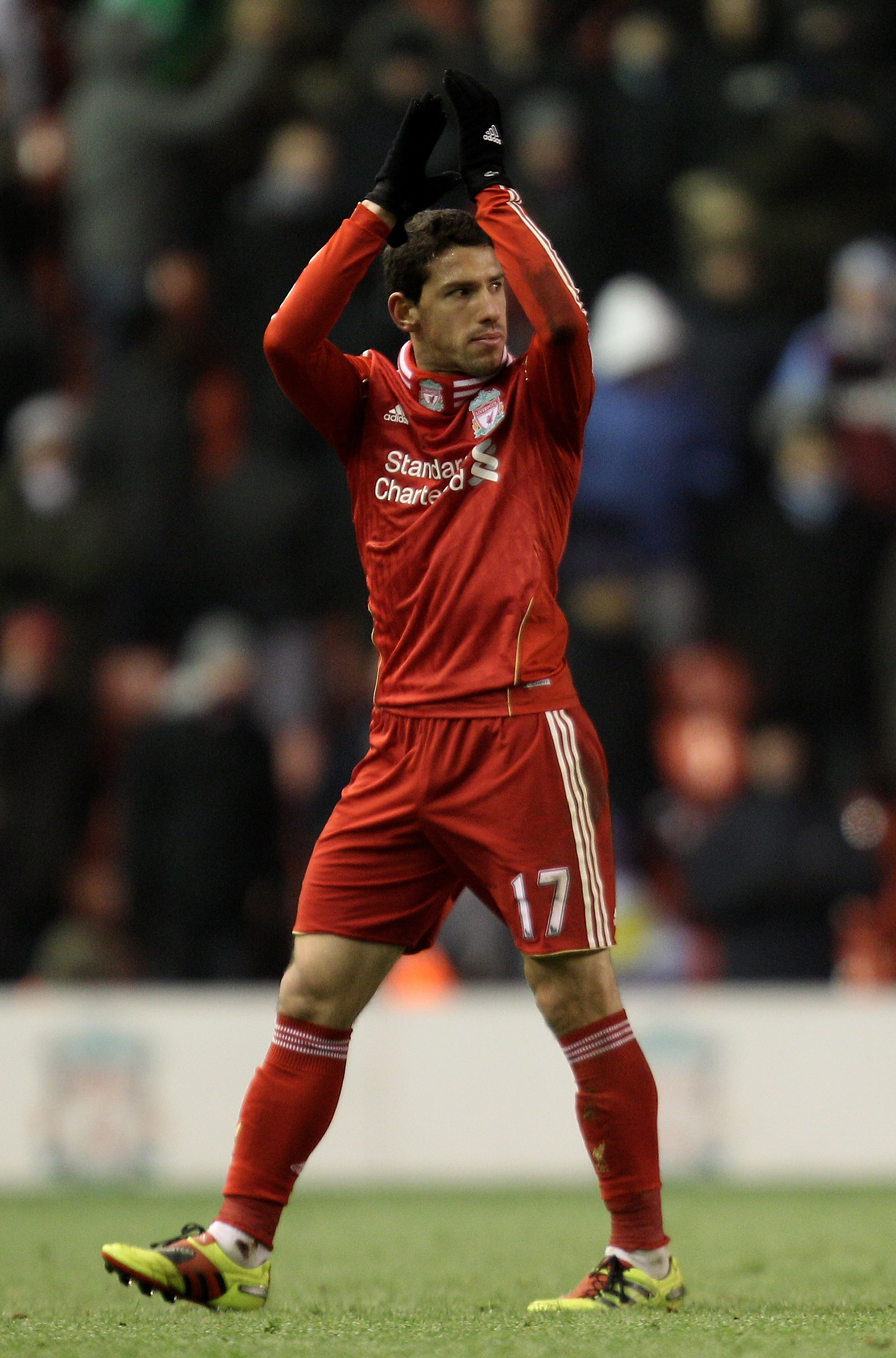 LIVERPOOL, ENGLAND - DECEMBER 06:   Maxi Rodriguez of Liverpool acknowledges the crowd during the Barclays Premier League match between Liverpool and Aston Villa at Anfield on December 6, 2010 in Liverpool, England. (Photo by Mark Thompson/Getty Images)
