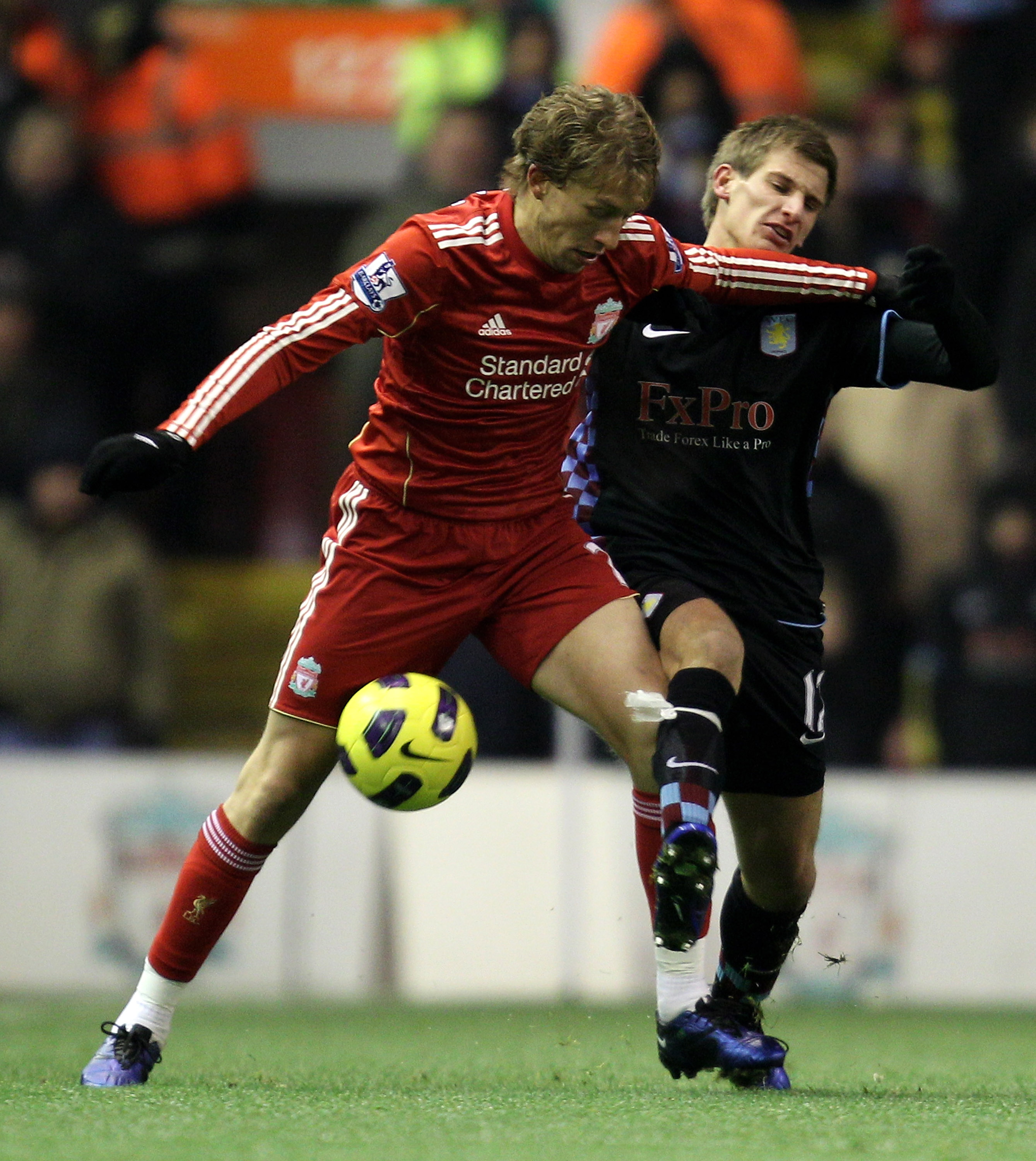 LIVERPOOL, ENGLAND - DECEMBER 06:  Marc Albrighton of Aston Villa tangles with Lucas of Liverpool during the Barclays Premier League match between Liverpool and Aston Villa at Anfield on December 6, 2010 in Liverpool, England.  (Photo by Mark Thompson/Get