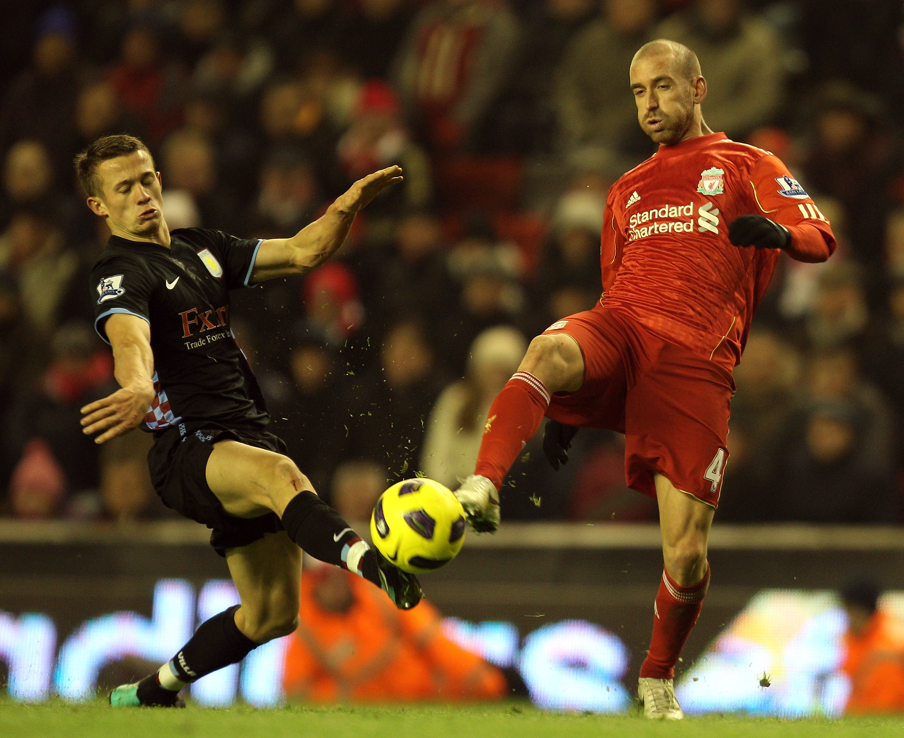 LIVERPOOL, ENGLAND - DECEMBER 06:  Jonathan Hogg of Aston Villa competes with Raul Meireles of Liverpool during the Barclays Premier League match between Liverpool and Aston Villa at Anfield on December 6, 2010 in Liverpool, England. (Photo by Mark Thomps