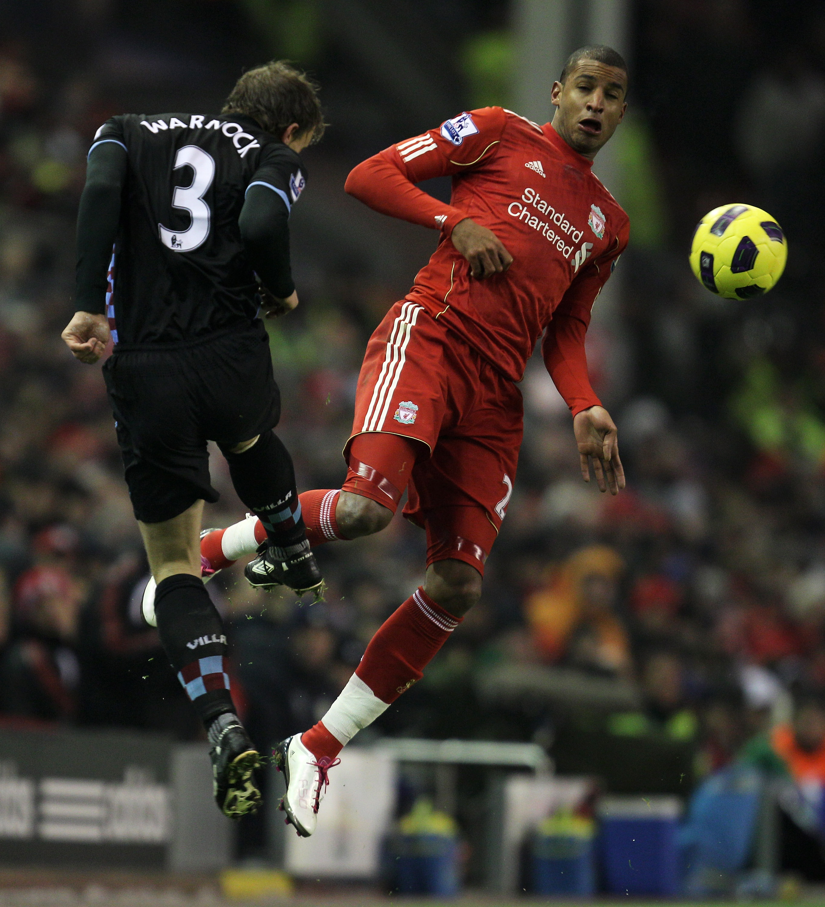 LIVERPOOL, ENGLAND - DECEMBER 06:  Stephen Warnock of Aston Villa competes with David Ngog of Liverpool during the Barclays Premier League match between Liverpool and Aston Villa at Anfield on December 6, 2010 in Liverpool, England. (Photo by Mark Thompso
