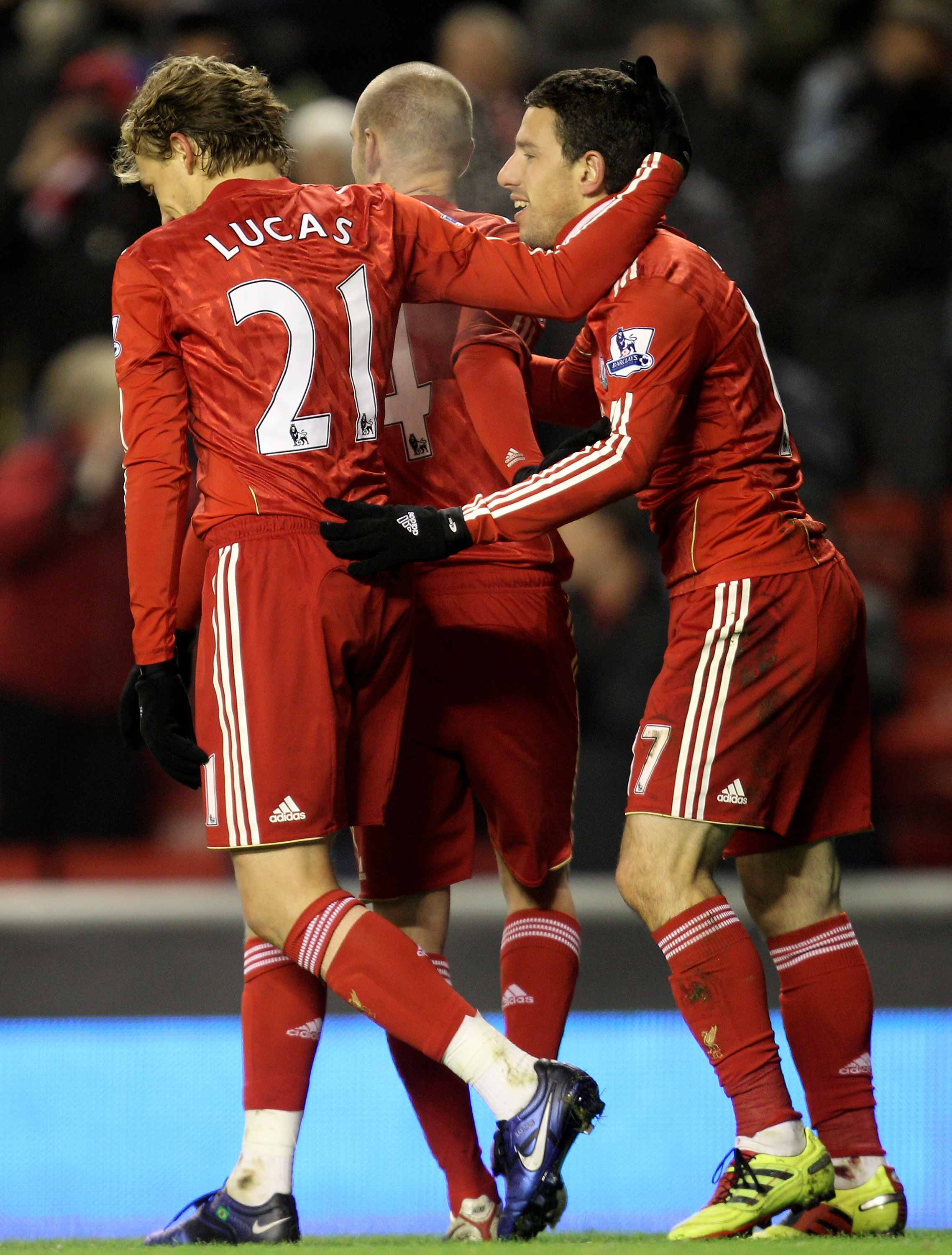 LIVERPOOL, ENGLAND - DECEMBER 06:   Maxi Rodriguez of Liverpool is congratulated by team mate Lucas after scoring his team's third goal during the Barclays Premier League match between Liverpool and Aston Villa at Anfield on December 6, 2010 in Liverpool,