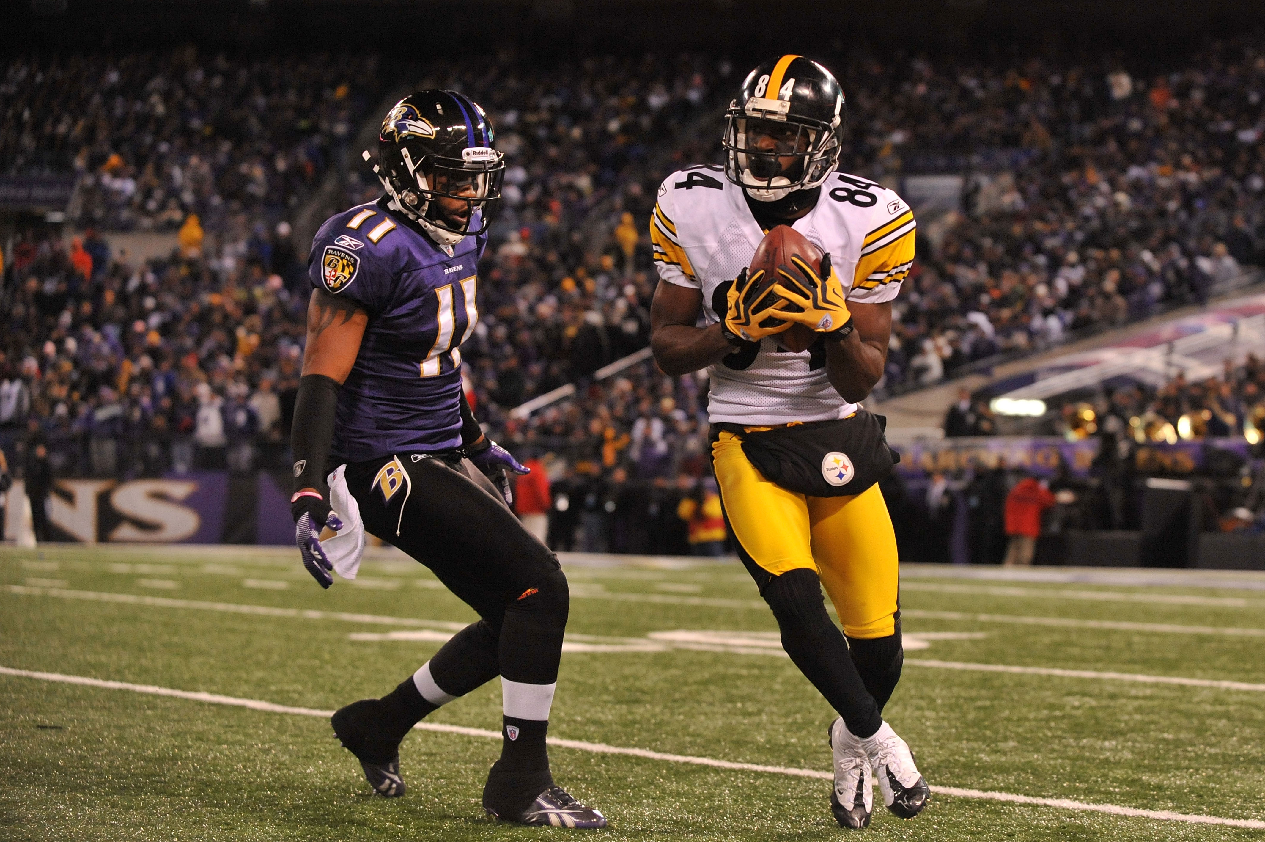BALTIMORE, MD - DECEMBER 05:  Wide receiver Antonio Brown #84 of the Pittsburgh Steelers catches the ball against wide receiver Marcus Smith #11 of the the Baltimore Ravens during the fourth quarter of the game at M&T Bank Stadium on December 5, 2010 in B