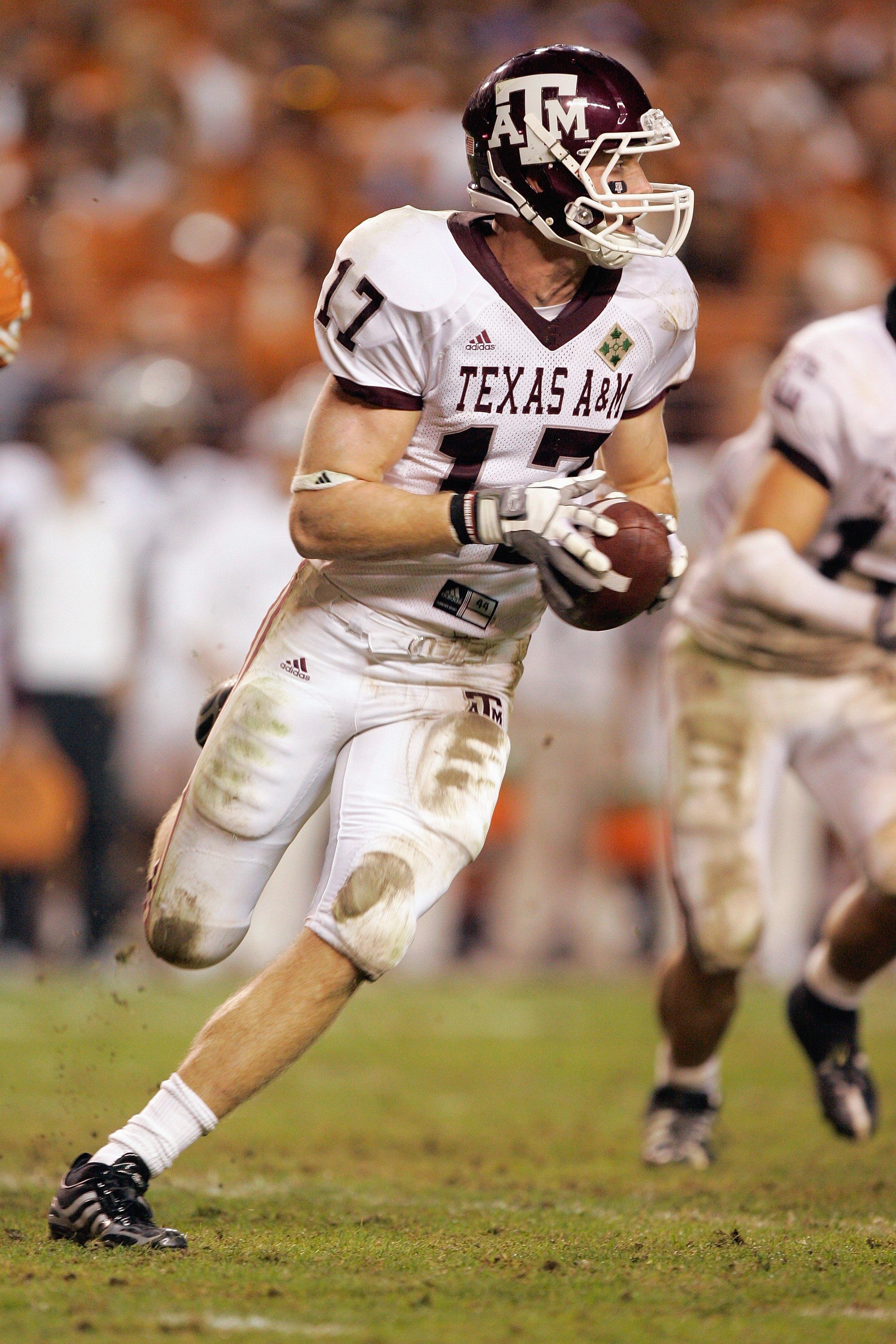 AUSTIN, TX - NOVEMBER 27: Quarterback  Ryan Tannehill #17 of the Texas A&M Aggies runs the ball against the Texas Longhorns on November 27, 2008 at Darrell K Royal-Texas Memorial Stadium in Austin, Texas.  Texas won 49-9. (Photo by Brian Bahr/Getty Images