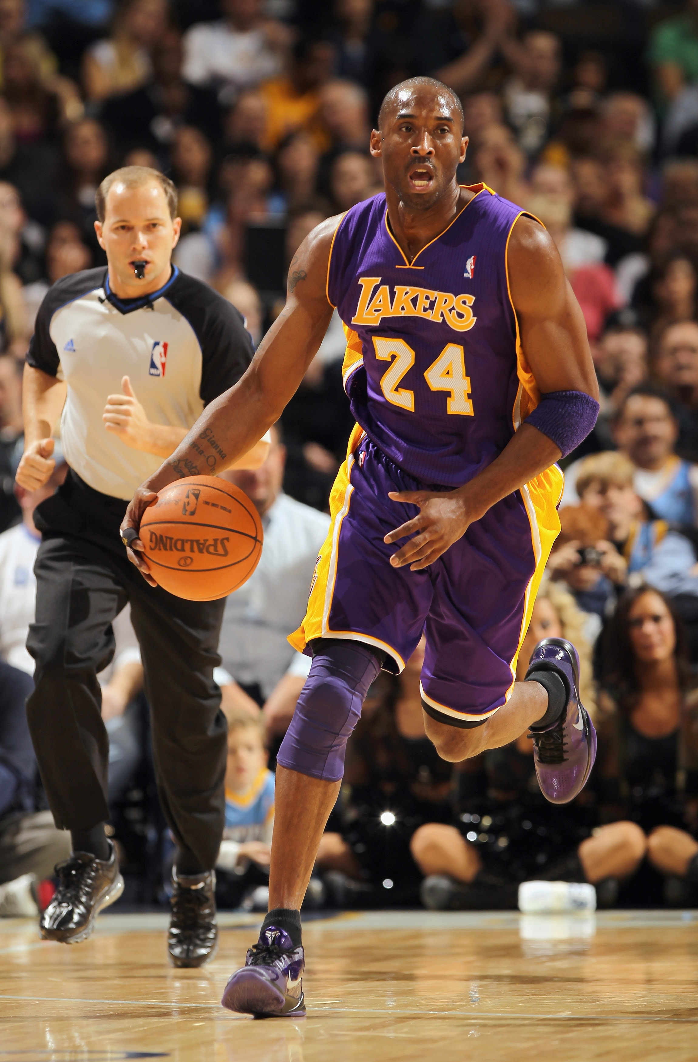 DENVER - NOVEMBER 11:  Kobe Bryant #24 of the Los Angeles Lakers dribbles the ball upcourt against the Denver Nuggets at the Pepsi Center on November 11, 2010 in Denver, Colorado. The Nuggets defeated the Lakers 118-112.  NOTE TO USER: User expressly ackn