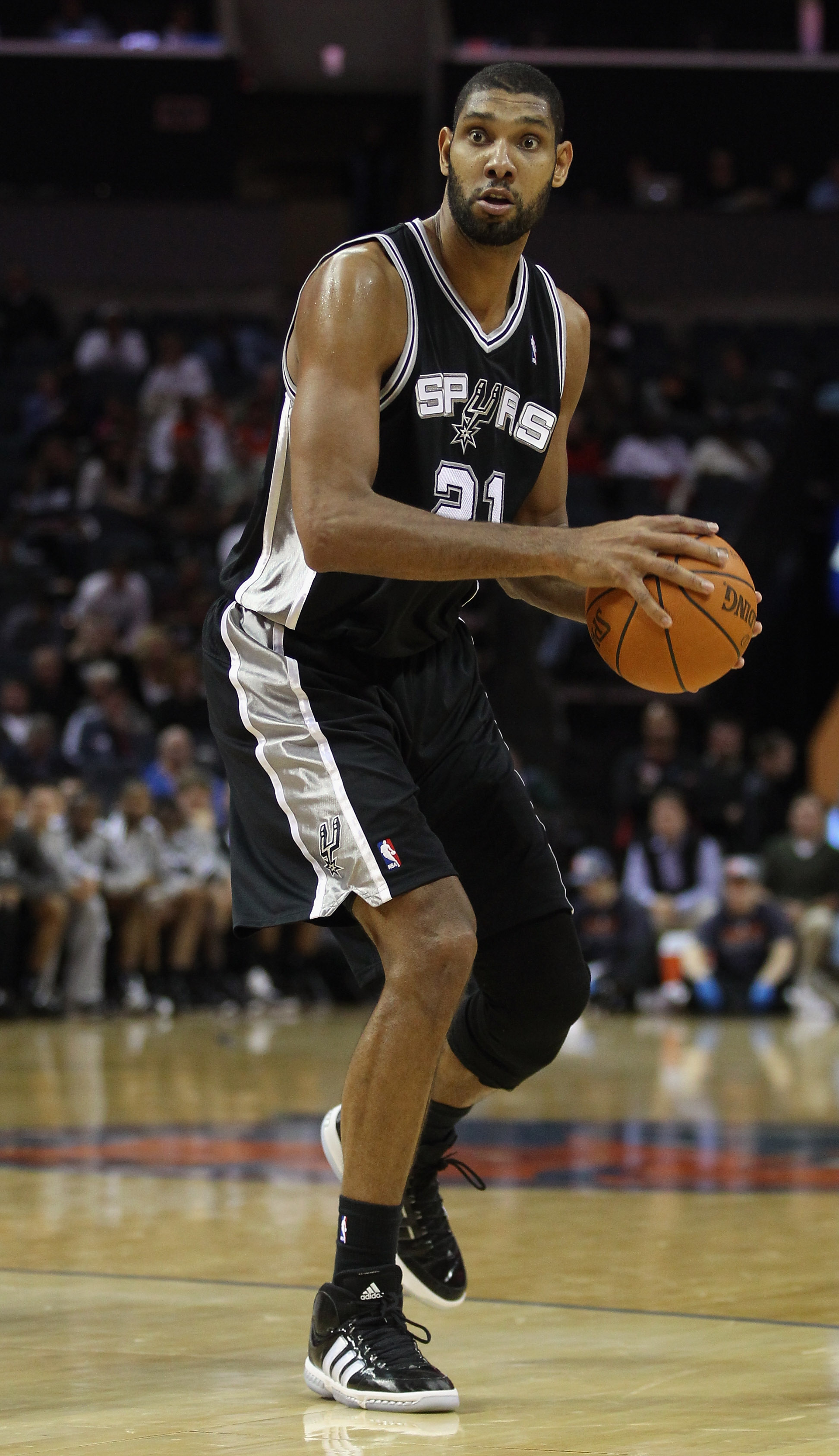 CHARLOTTE, NC - NOVEMBER 08:  Tim Duncan #21 of the San Antonio Spurs against the Charlotte Bobcats during their game at Time Warner Cable Arena on November 8, 2010 in Charlotte, North Carolina.  NOTE TO USER: User expressly acknowledges and agrees that,