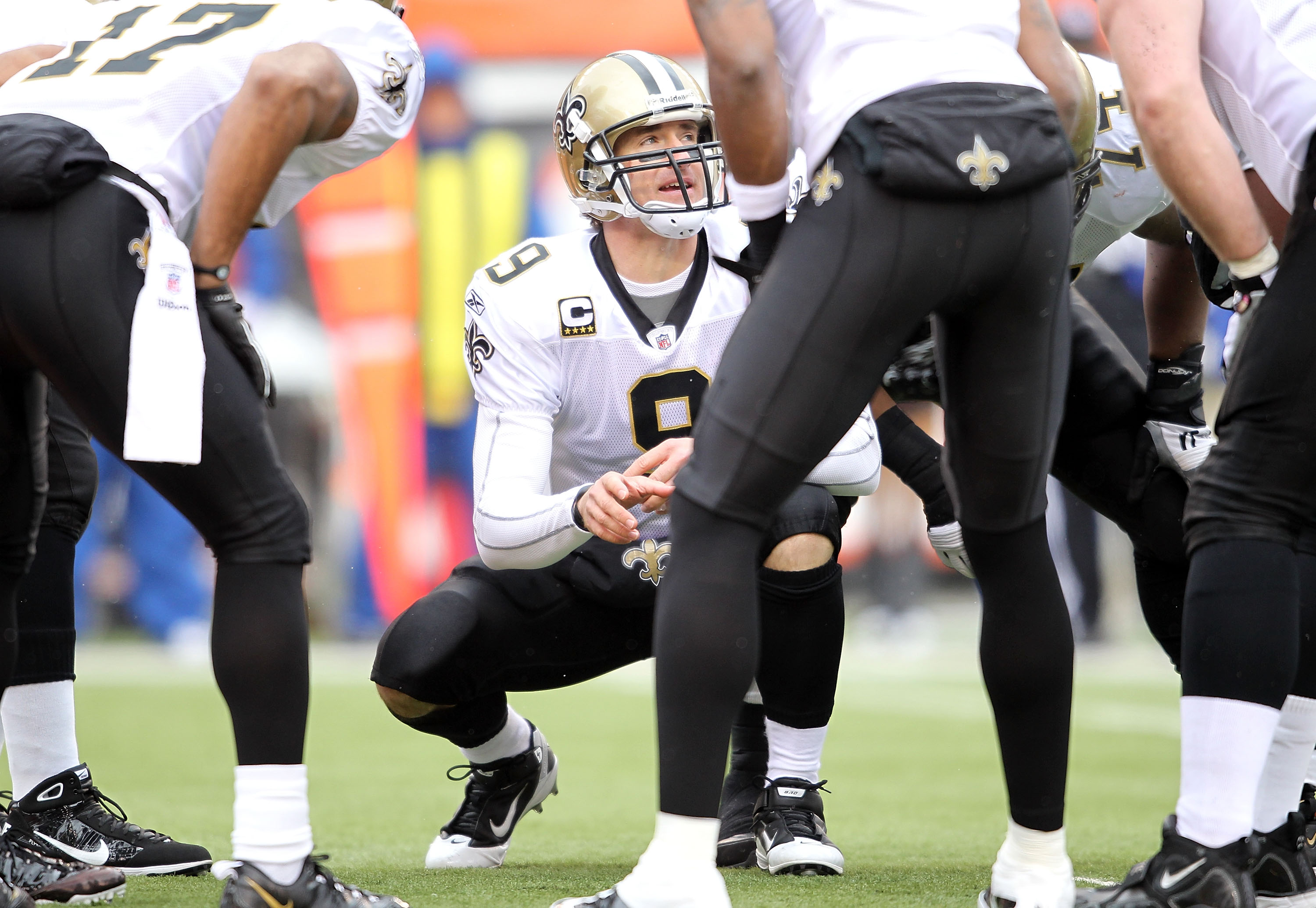 CINCINNATI, OH - DECEMBER 05:  Dree Brees #9 of the New Orleans Saints gives instructions to his team during the NFL game against the Cincinnati Bengals at Paul Brown Stadium on December 5, 2010 in Cincinnati, Ohio.  The Saints won 34-30.  (Photo by Andy