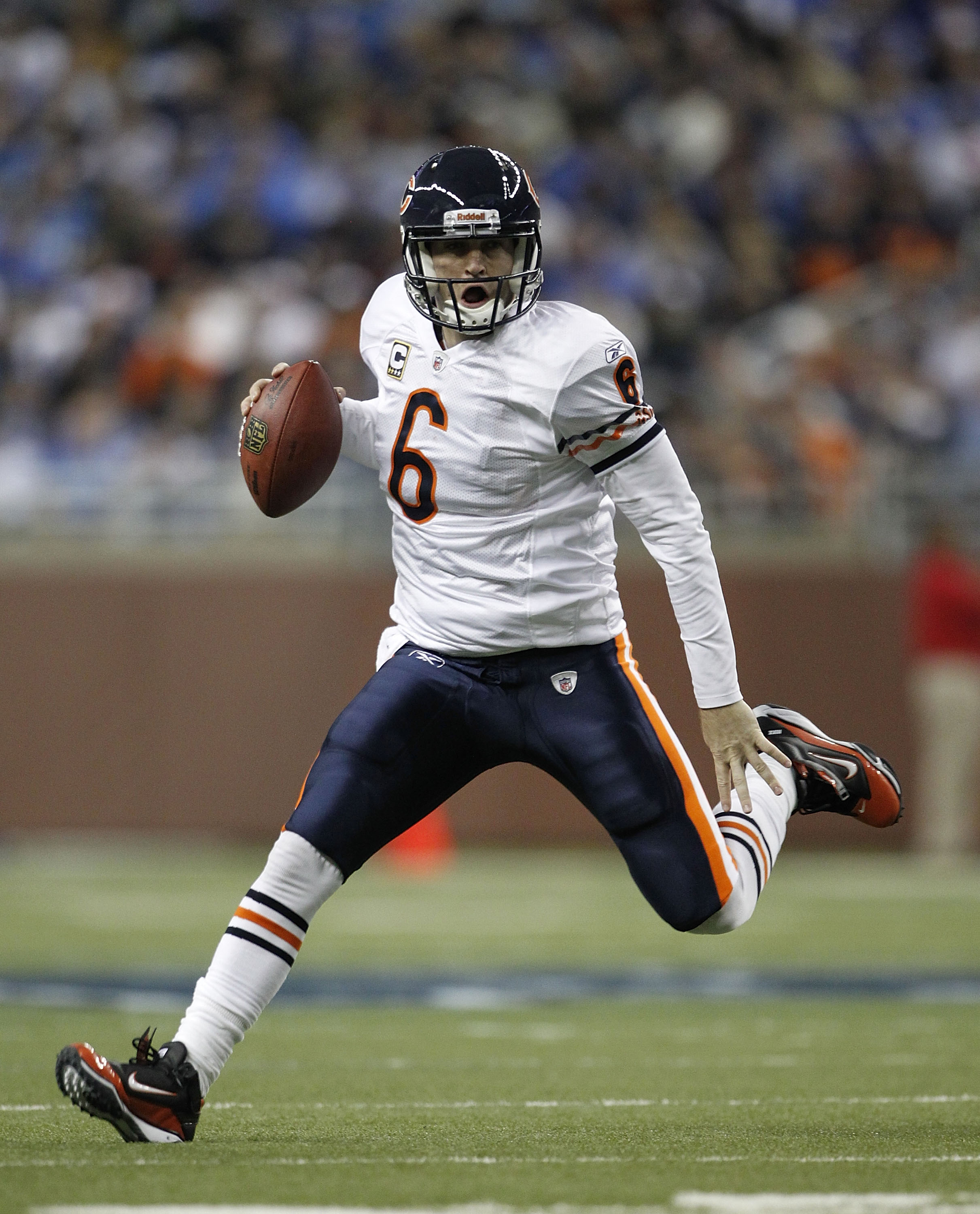 DETROIT - DECEMBER 05: Jay Cutler #6 of the Chicago Bears scrambles for a first down during the fourth quarter of the game against the Detroit Lions at Ford Field on December 5, 2010 in Detroit, Michigan. The Bears defeated the Lions 24-20.  (Photo by Leo