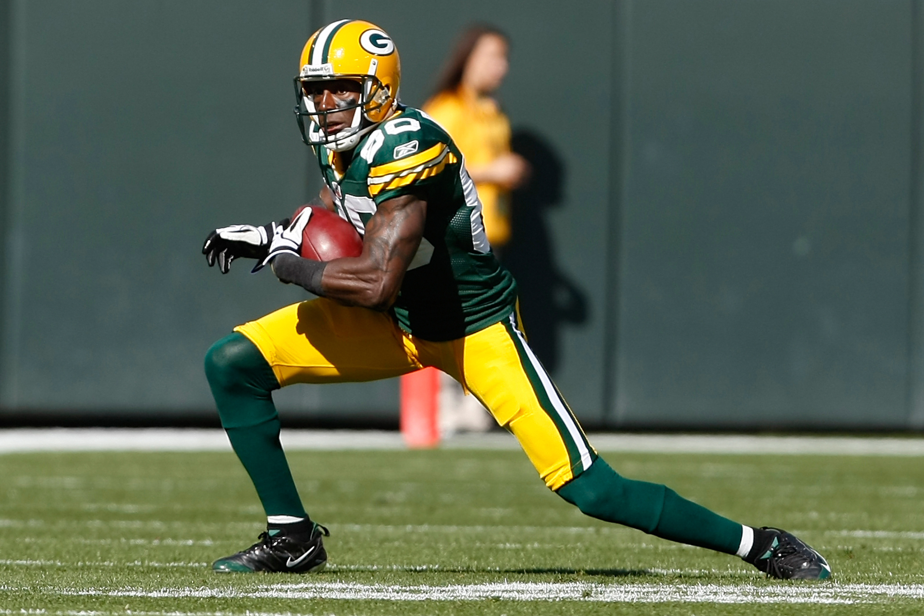 GREEN BAY, WI - OCTOBER 17: Donald Driver #80 of the Green Bay Packers runs against the Miami Dolphins at Lambeau Field on October 17, 2010 in Green Bay, Wisconsin. (Photo by Scott Boehm/Getty Images)