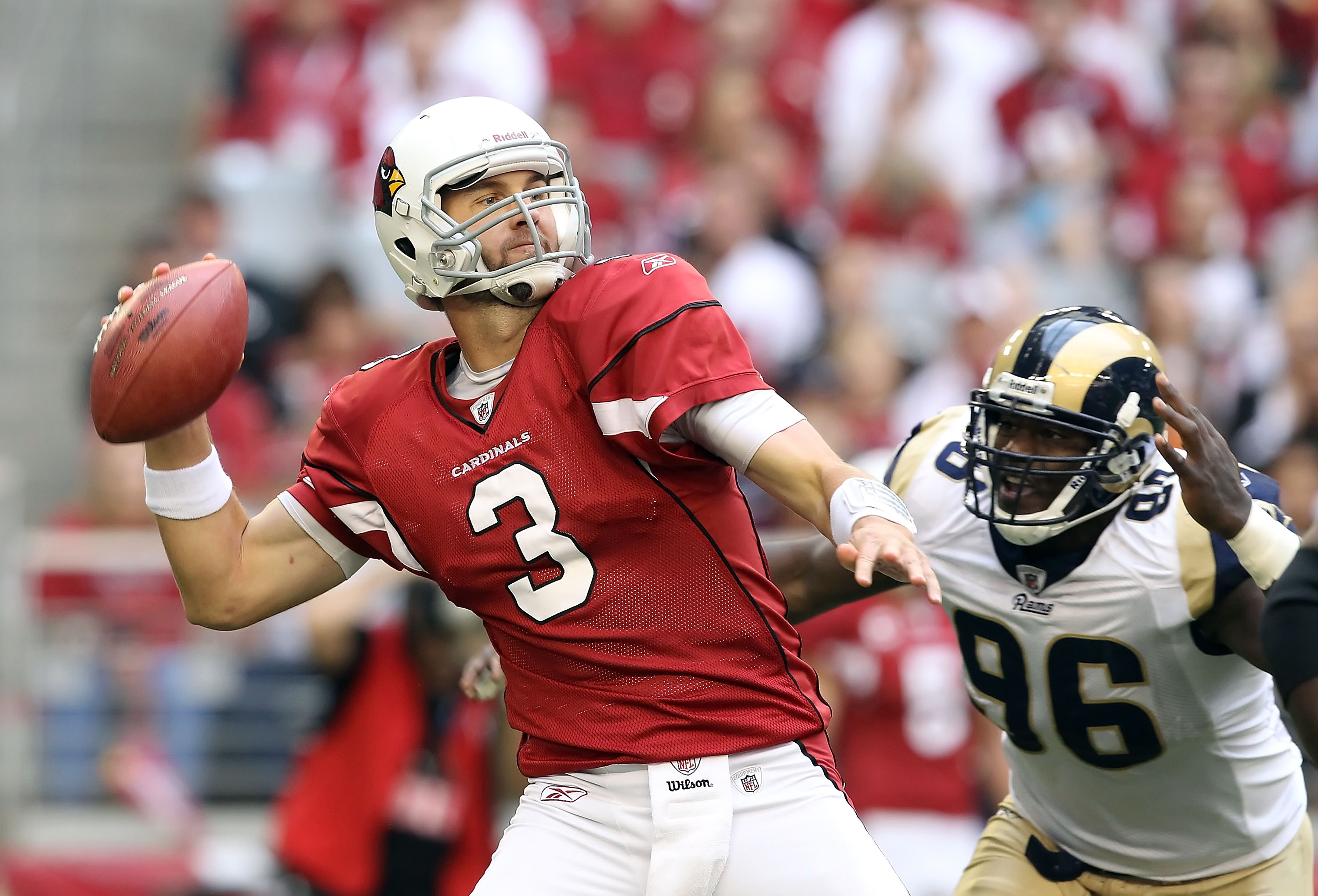 GLENDALE, AZ - DECEMBER 05:  Quarterback Derek Anderson #3 of the Arizona Cardinals throws a pass under pressure from James Hall #96 of the St. Louis Rams during the NFL game at the University of Phoenix Stadium on December 5, 2010 in Glendale, Arizona.