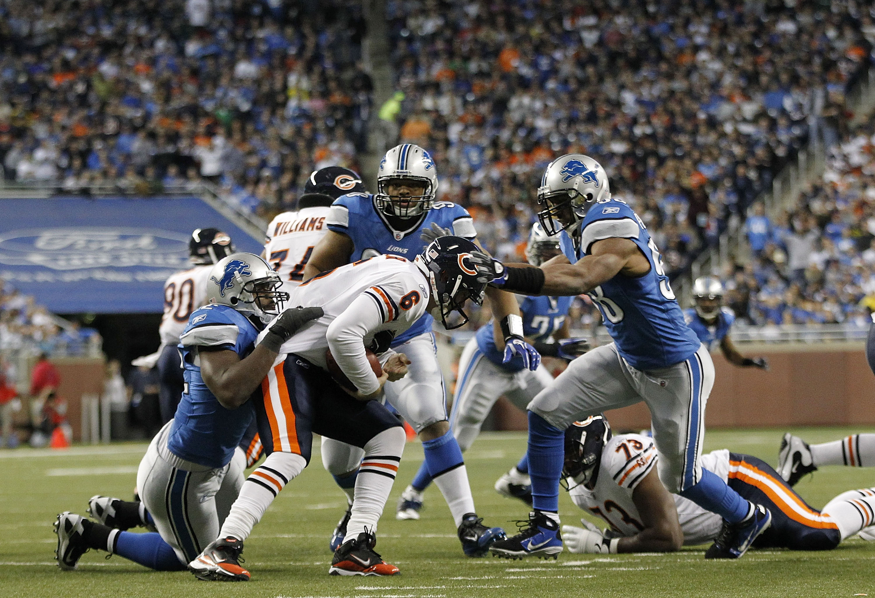 DETROIT - DECEMBER 05: Jay Cutler #6 of the Chicago Bears is sacked by Cliff Avril #92 and Julian Peterson #98 of the Detroit Lions as Ndamukong Suh #90 looks on during the game at Ford Field on December 5, 2010 in Detroit, Michigan. The Bears defeated th