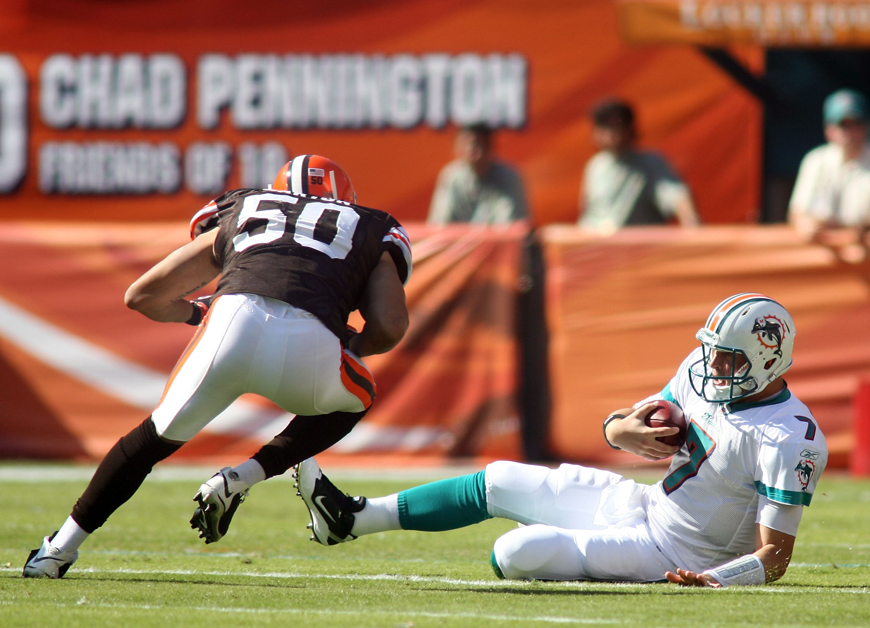 MIAMI - DECEMBER 05:  Quarterback Chad Henne #7 of the Miami Dolphins is hit late by Linebacker Eric Barton #50 of the Cleveland Browns while sliding at Sun Life Stadium on December 5, 2010 in Miami, Florida.  (Photo by Marc Serota/Getty Images)