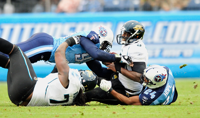 NASHVILLE, TN - DECEMBER 05:  Marques Douglas #99 and Chris Hope #24 of the Tennessee Titans sack quarterback David Garrard #9 of the Jacksonville Jaguars at LP Field on December 5, 2010 in Nashville, Tennessee. The Jaguars won 17-6. (Photo by Grant Halve