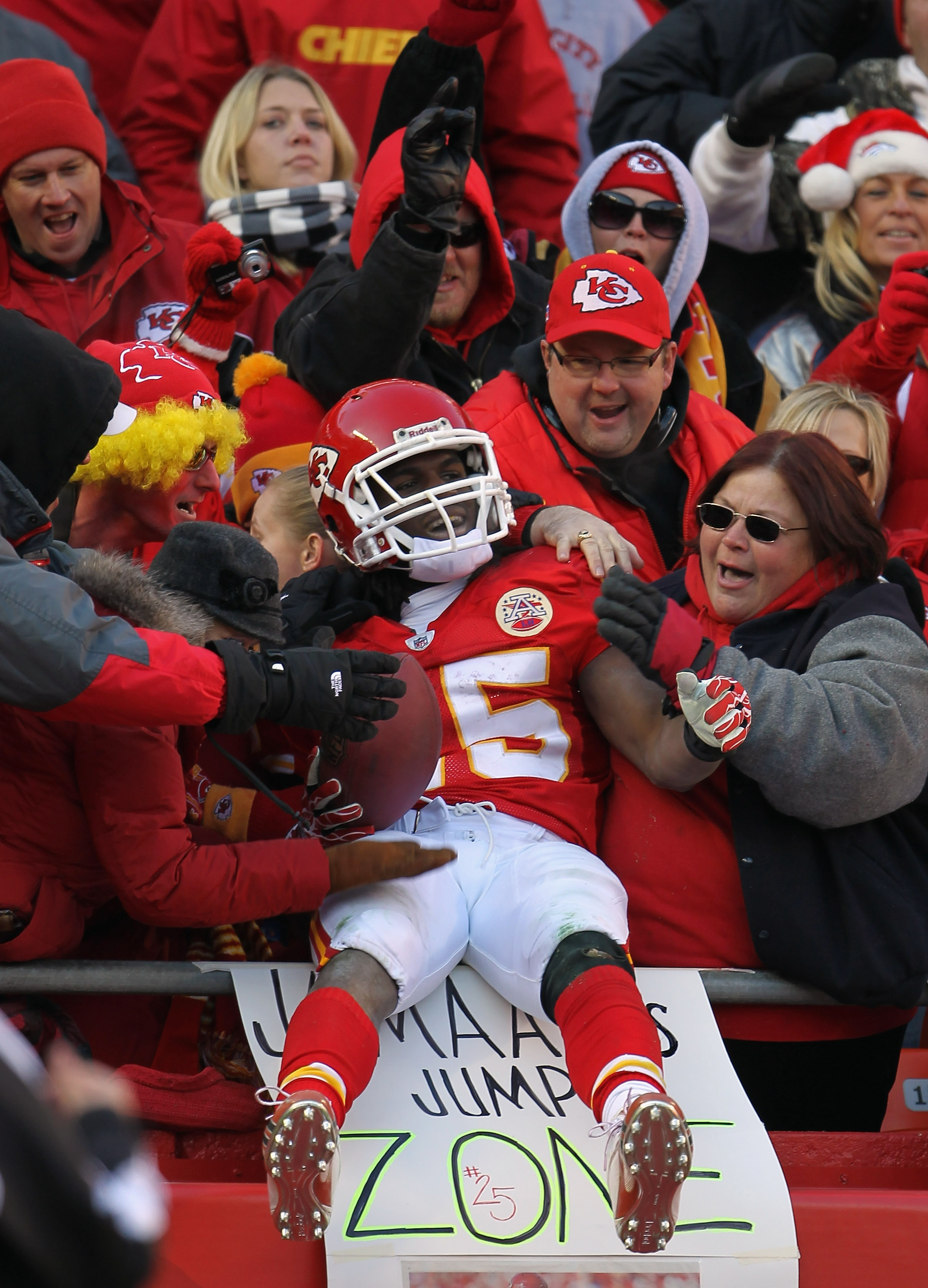 KANSAS CITY, MO - DECEMBER 05:  Jamaal Charles #25 of the Kansas City Chiefs celebrates by jumping into the crowd after scoring a touchdown that was eventually called back during the game against the Denver Broncos on December 5, 2010 at Arrowhead Stadium