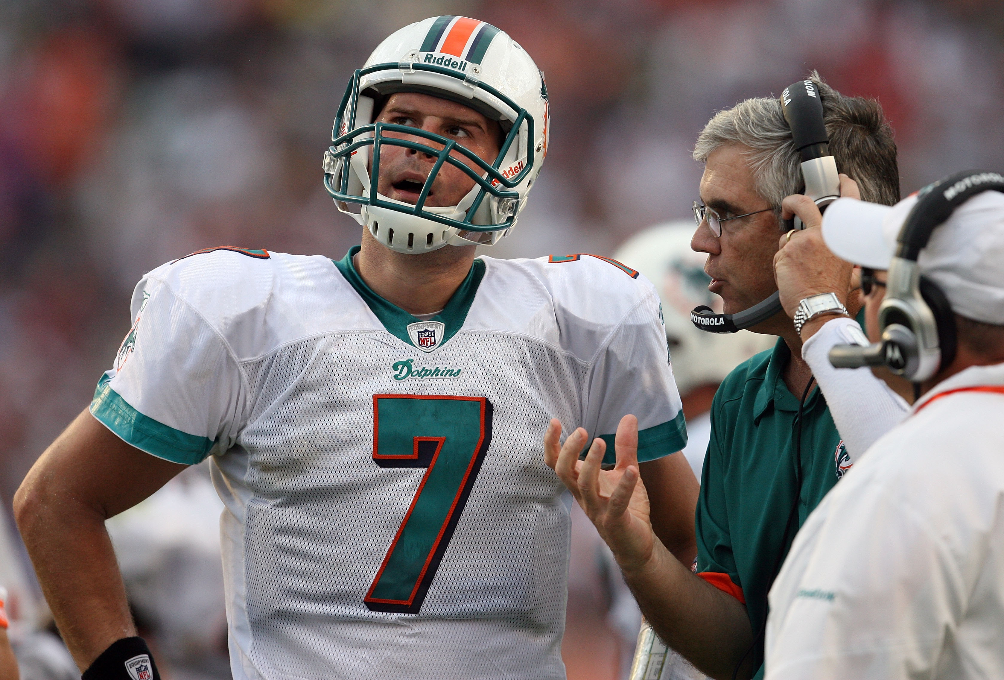 MIAMI - DECEMBER 06:  Quarterback Chad Henne #7 of the Miami Dolphins talks with offensive coordinator Dan Henning and head coach Tony Sparano late in the game against the New England Patriots at Land Shark Stadium on December 6, 2009 in Miami, Florida. T