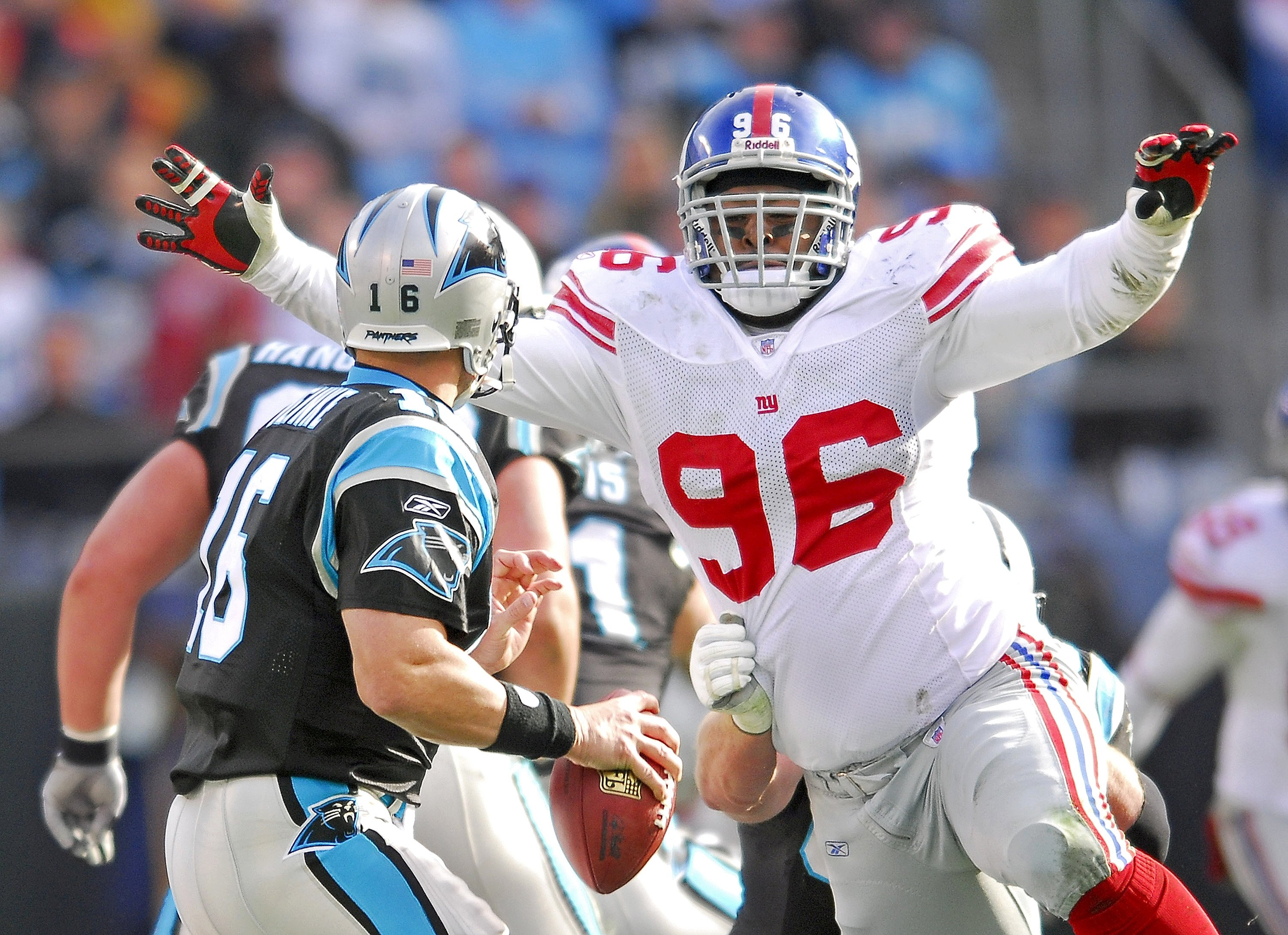 CHARLOTTE, NC - DECEMBER 10: Barry Cofield #96 of the New York Giants pressures quarterback Chris Weinke #16 of the Carolina Panthers during an NFL game on December 10, 2006, at Bank of America Stadium in Charlotte, North Carolina. (Photo By Grant Halvers
