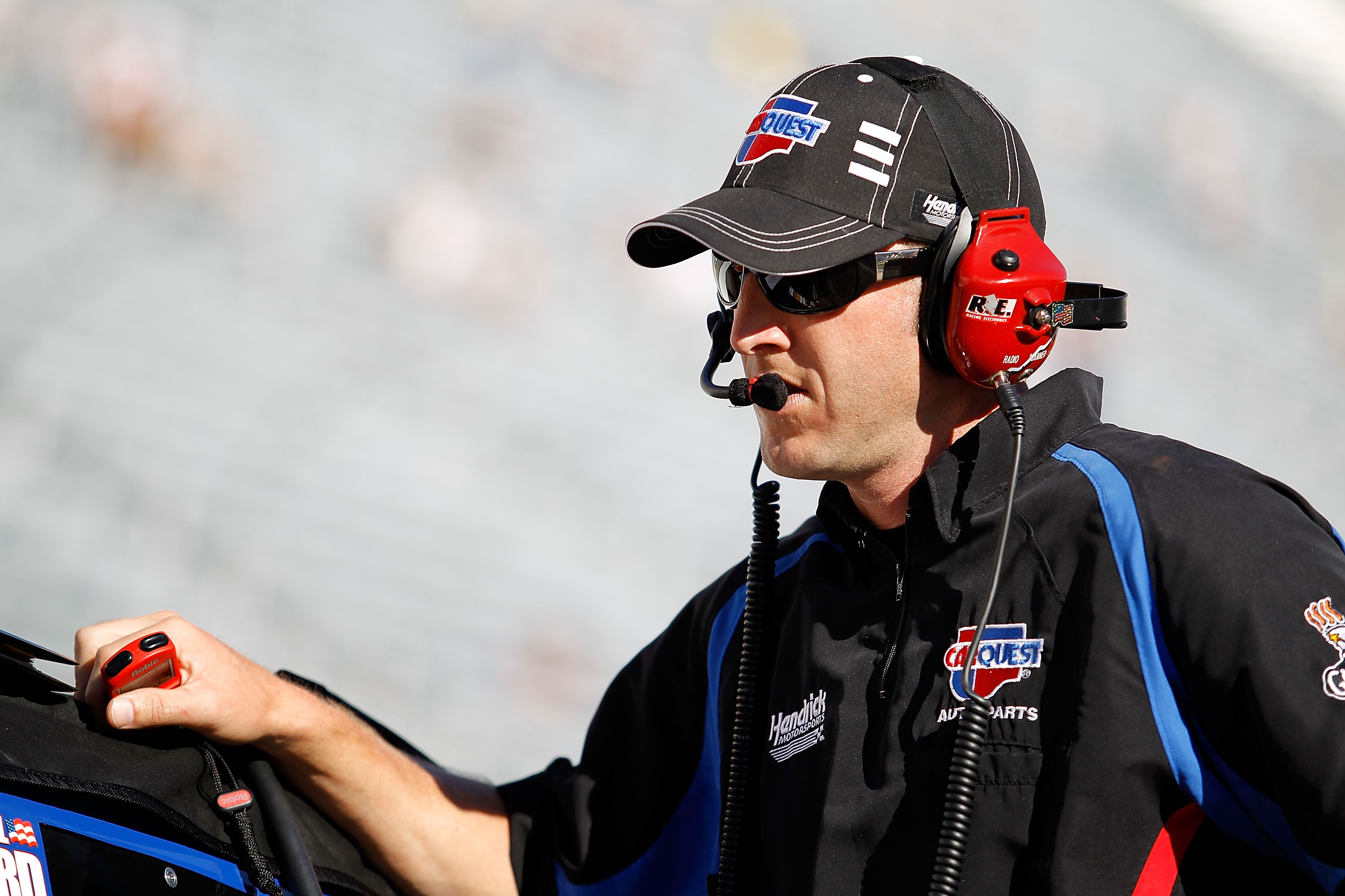BRISTOL, TN - AUGUST 20:  Alan Gustafson, crew chief of the #5 CARQUEST Auto Parts Chevrolet, stands on the grid during qualifying for the NASCAR Sprint Cup Series IRWIN Tools Night Race at Bristol Motor Speedway on August 20, 2010 in Bristol, Tennessee.