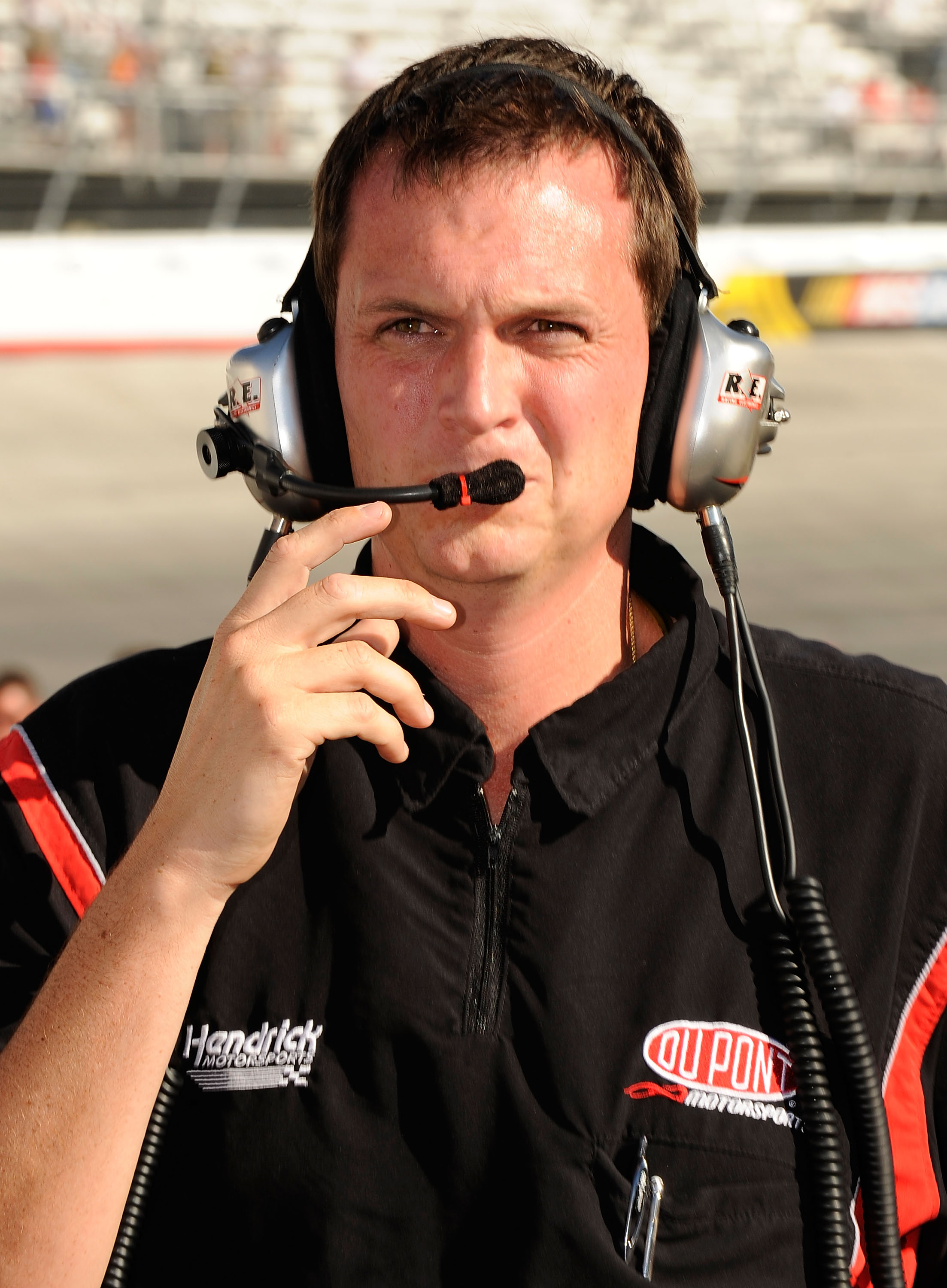 BRISTOL, TN - AUGUST 20:  Steve Letarte, crew chief of the #24 DuPont Chevrolet, driven by Jeff Gordon, walks on the grid to talk to NASCAR Officials after Gordon hit the wall around turn four before taking the green flag to qualify for the NASCAR Sprint