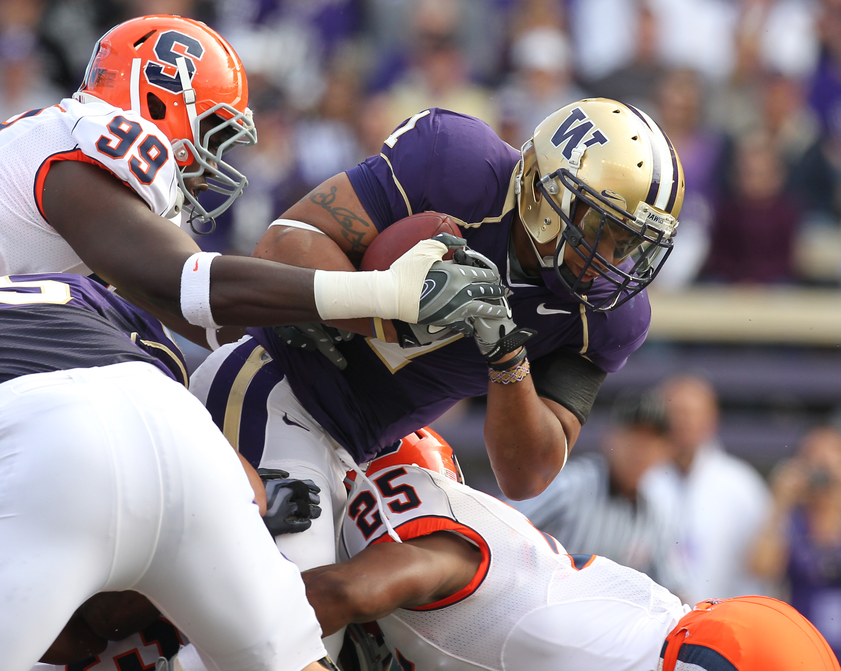 SEATTLE - SEPTEMBER 11:  Running back Chris Polk #1 of the Washington Huskies rushes against Derrell Smith #25 of the Syracuse Orange on September 11, 2010 at Husky Stadium in Seattle, Washington. (Photo by Otto Greule Jr/Getty Images)