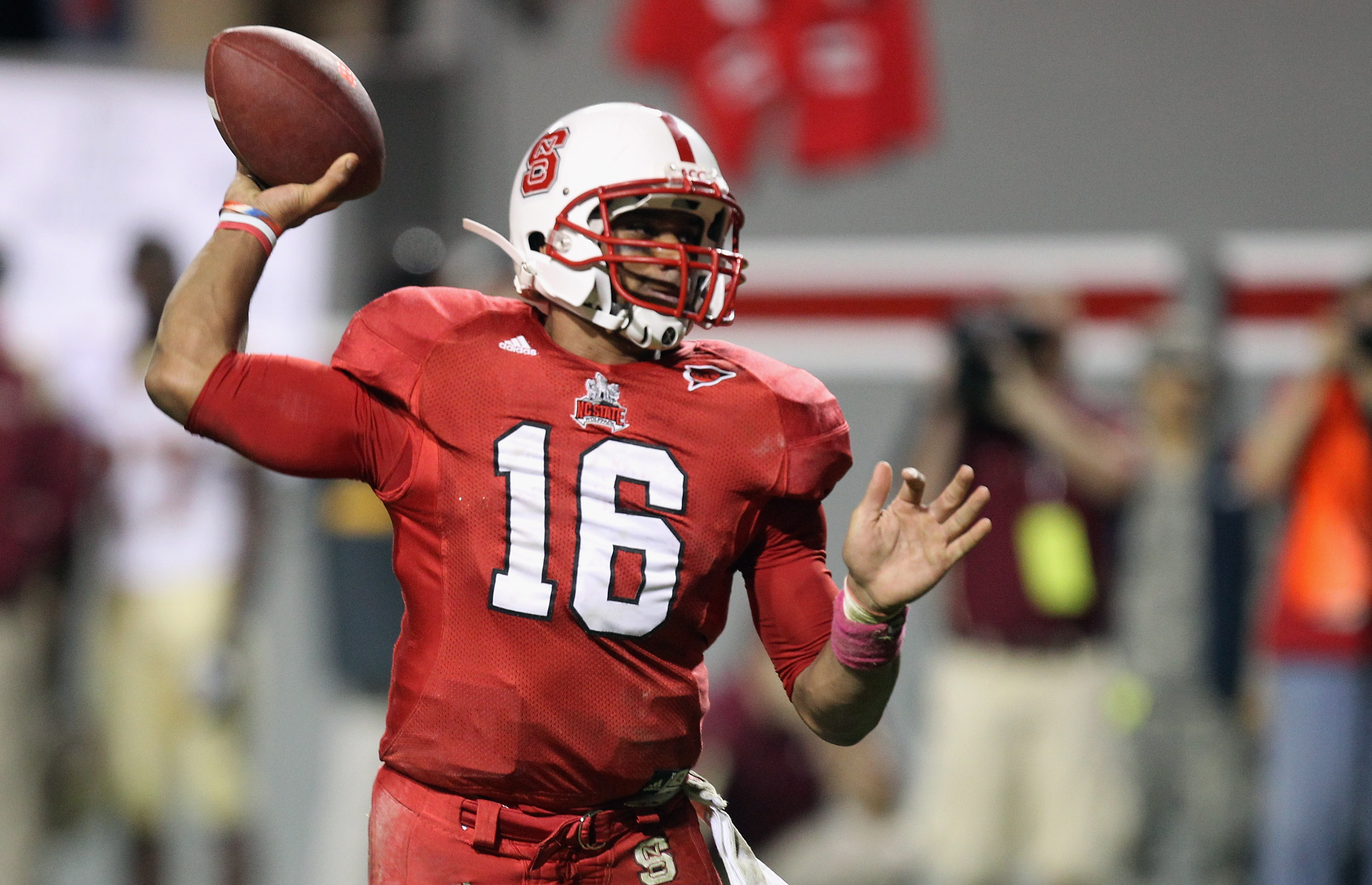 RALEIGH, NC - OCTOBER 28:  Russell Wilson #16 of the North Carolina State Wolfpack throws the game winning touchdown against the Florida State Seminoles during their game at Carter-Finley Stadium on October 28, 2010 in Raleigh, North Carolina.  (Photo by