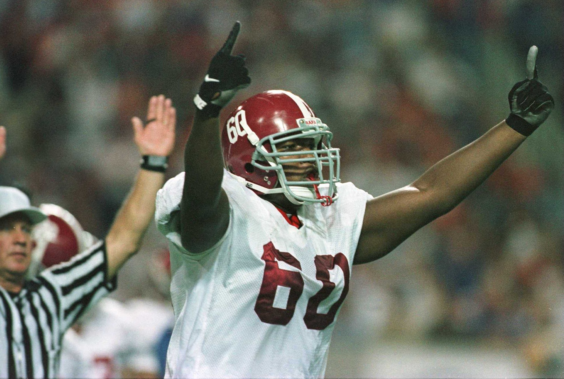 7 Dec 1996:  Chris Samuels #60 of Alabama celebrates a touchdown against Florida during the first half of the SEC Championship at the Georgia Dome in Atlanta, Georgia. Mandatory Credit: Andy Lyons/Allsport