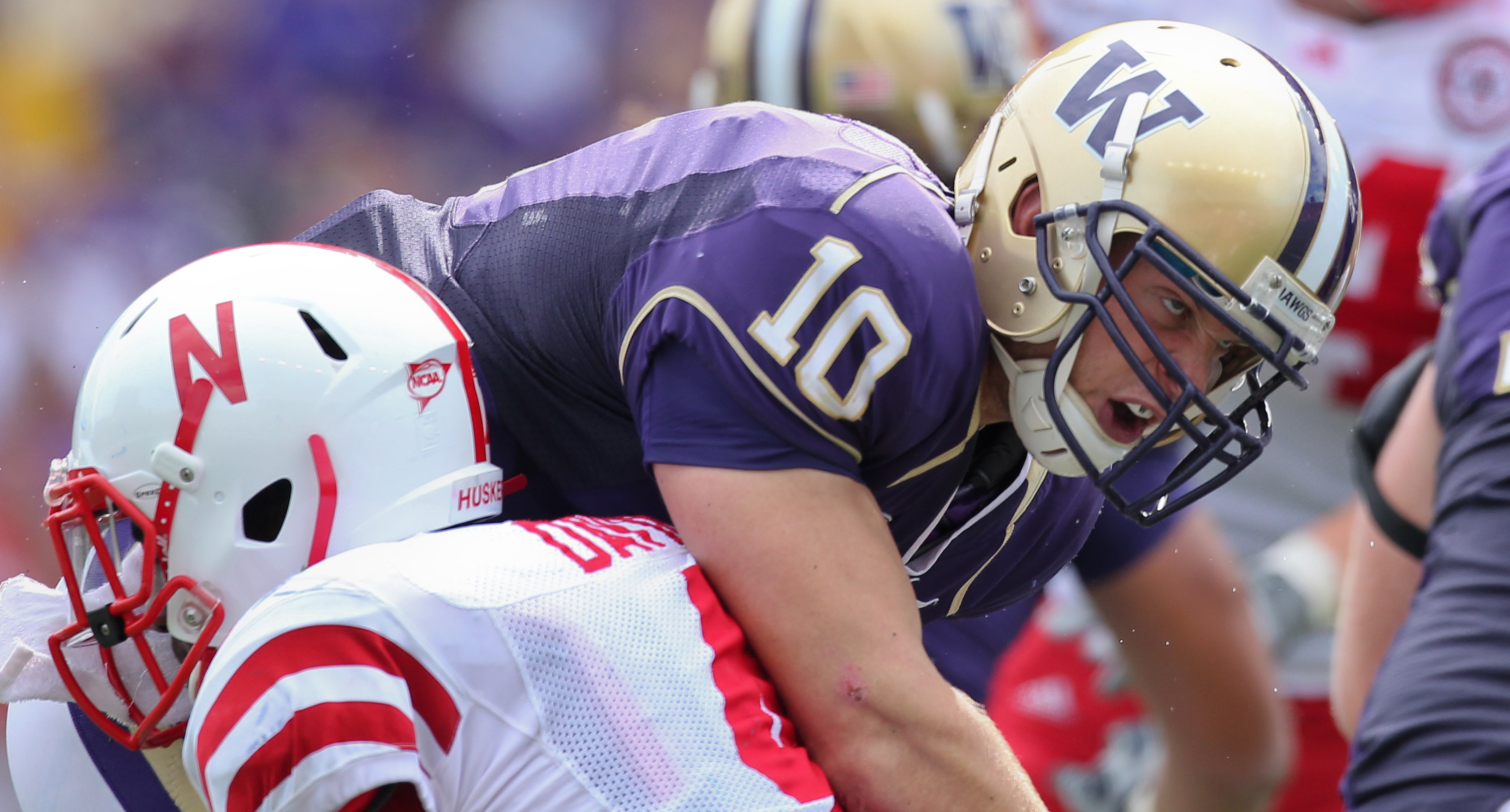 SEATTLE - SEPTEMBER 18: Quarterback Jake Locker #10 of the Washington Huskies is tackled by linebacker Lavonte David #4 of the Nebraska Cornhuskers on September 18, 2010 at Husky Stadium in Seattle, Washington. (Photo by Otto Greule Jr/Getty Images)