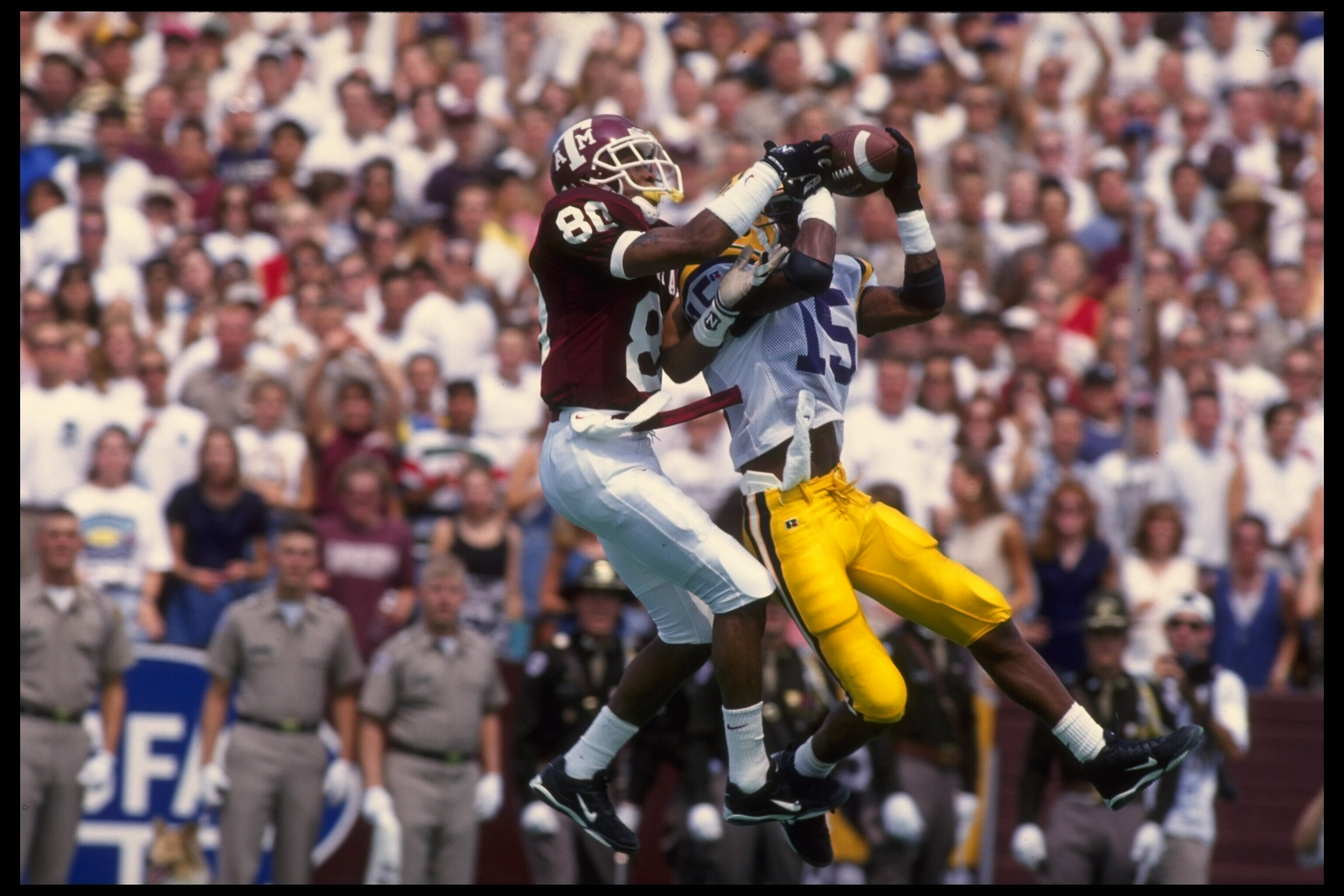2 SEP 1995:  TEXAS A&M WIDE RECEIVER ALBERT CONNELL #80 LEAPS OVER LSU DEFENSIVE BACK TROY TWILLIE #15 IN ATTEMPTS TO MAKE A CATCH DURING TEXAS A&M''S 33-17 WIN AT KYLE FIELD IN COLLEGE STATION, TEXAS.  MANDATORY CREDIT:  ROBERT SEALE/ALLSPORT