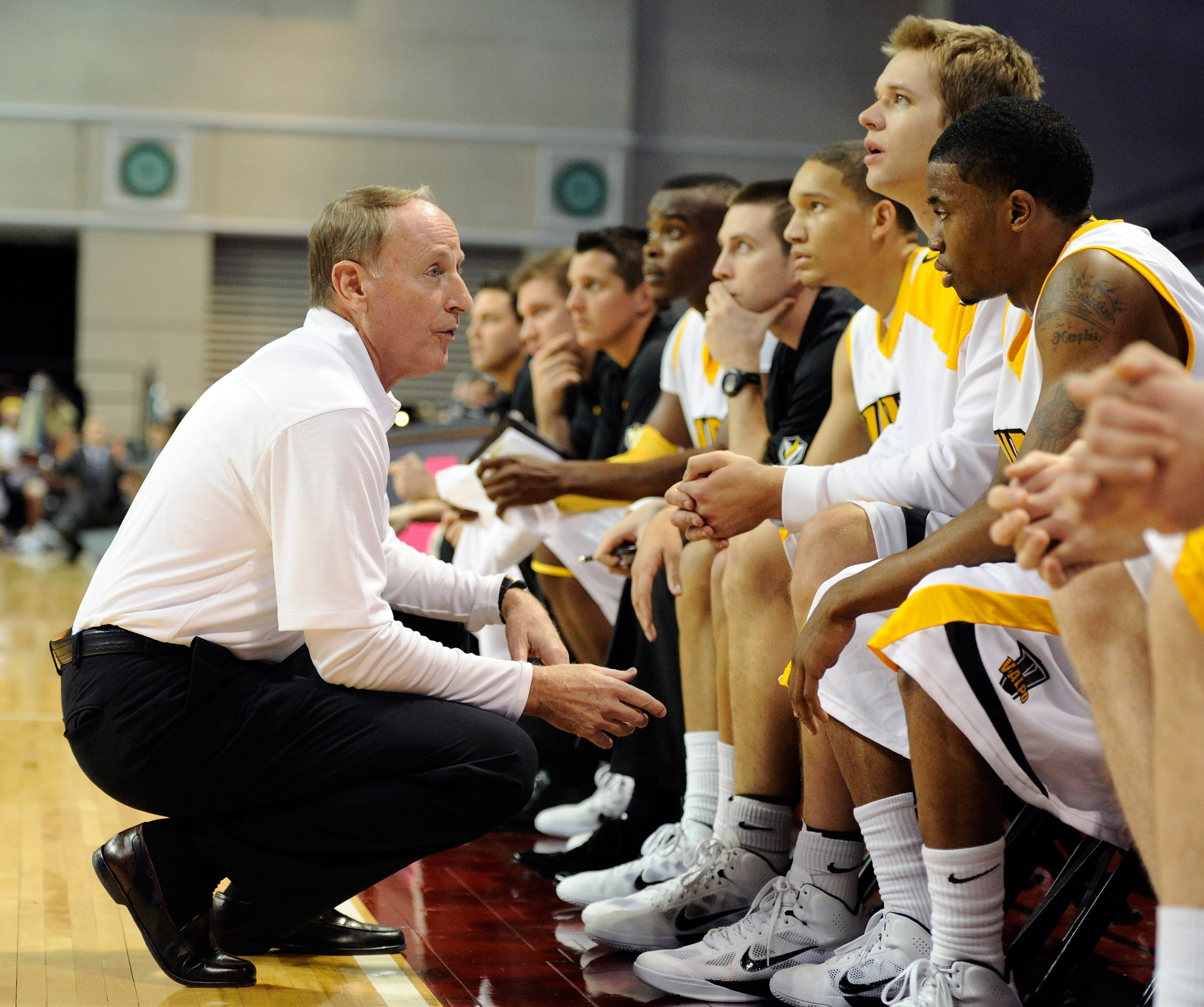 LAS VEGAS - NOVEMBER 26:  Head coach Homer Drew of the Valparaiso Crusaders talks to his players on the bench as they take on the Northern Colorado Bears during the third round of the Las Vegas Invitational at The Orleans Arena November 26, 2010 in Las Ve