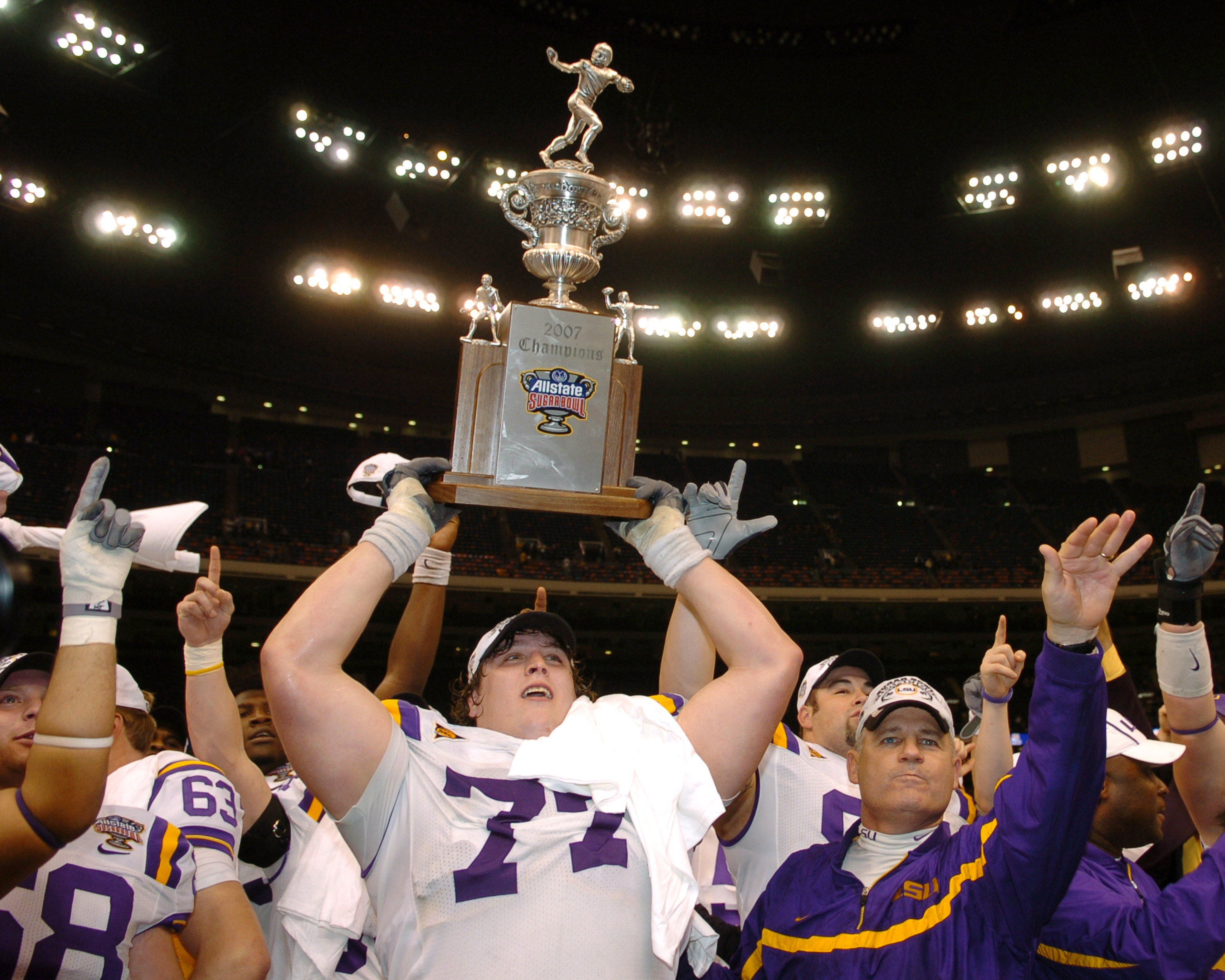 LSU coach Les Miles and offensive tackle Peter Dyakowski  with the championship trophy after a win against Notre Dame in the Allstate Sugar Bowl at the Superdome in New Orleans, Louisiana on January 3, 2007.  LSU won 41 - 14. (Photo by A. Messerschmidt/Ge