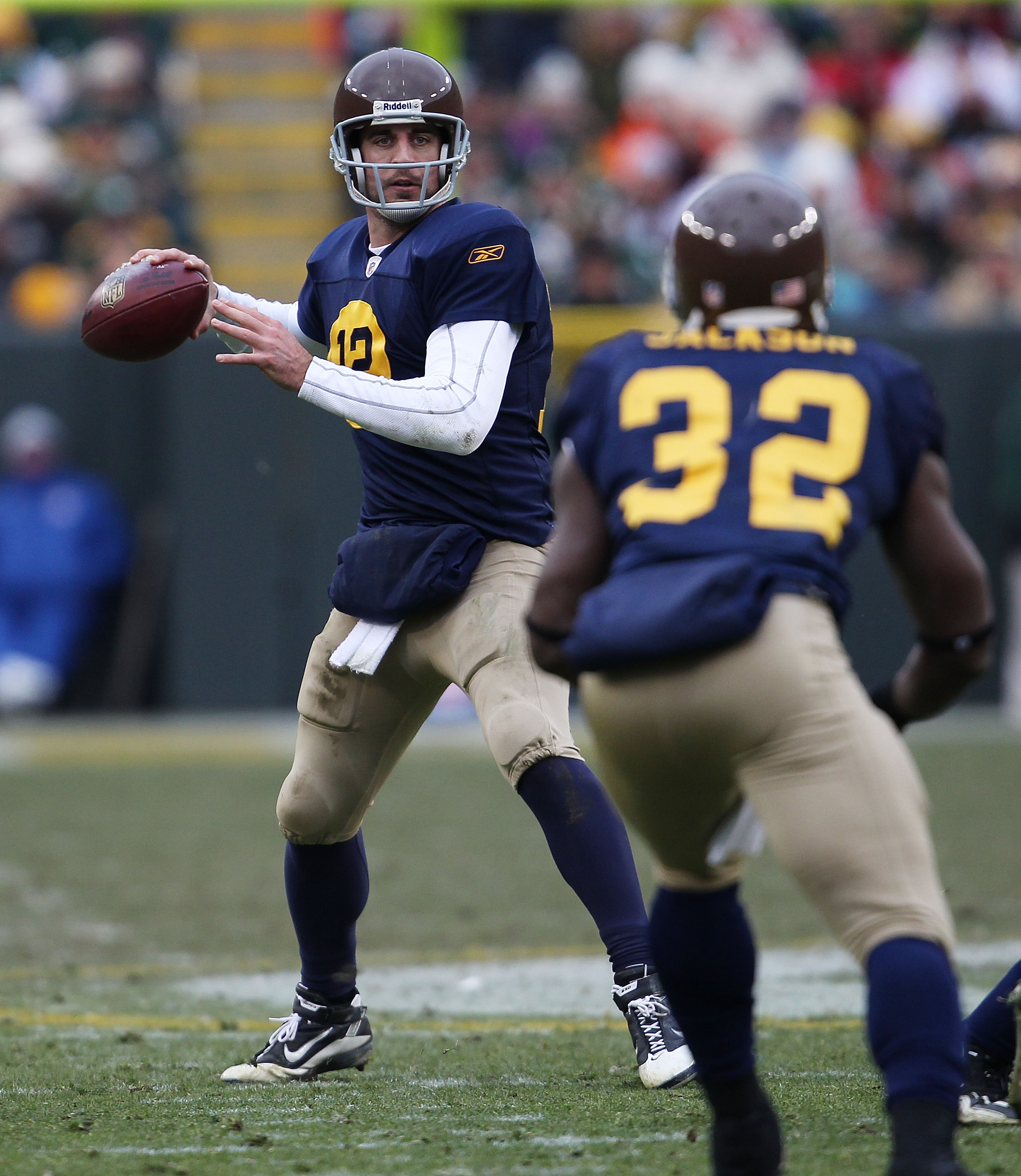 GREEN BAY, WI - DECEMBER 05: Aaron Rodgers #12 of the Green Bay Packers throws a pass to teammate Brandon Jakcson #32 against the San Francisco 49ers at Lambeau Field on December 5, 2010 in Green Bay, Wisconsin. The Packers defeated the 49ers 34-16. (Phot