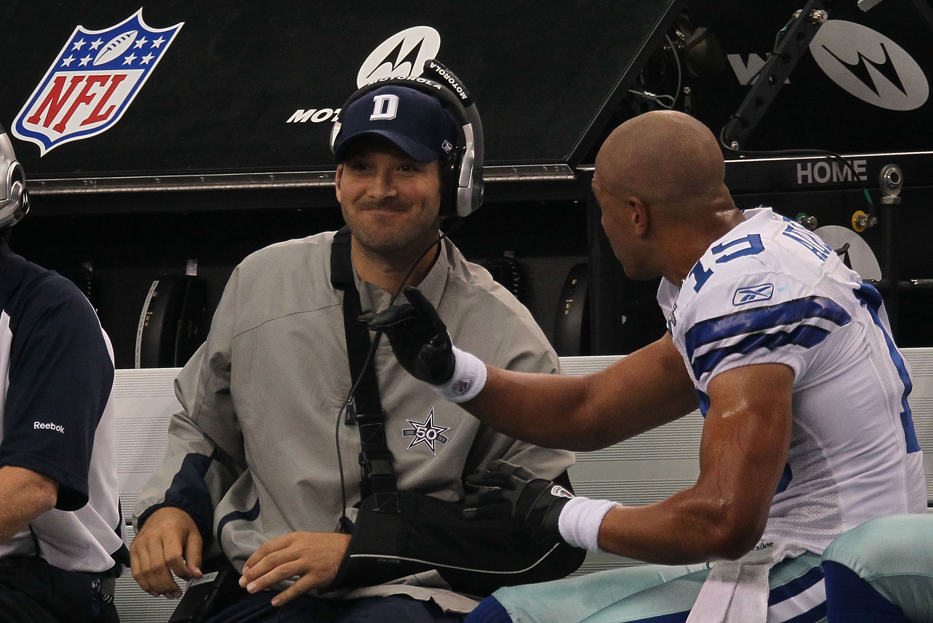 ARLINGTON, TX - OCTOBER 31:  Quarterback Tony Romo #9 talks with Miles Austin #19 of the Dallas Cowboys on the sidelines during a game against the Jacksonville Jaguars at Cowboys Stadium on October 31, 2010 in Arlington, Texas.  (Photo by Stephen Dunn/Get